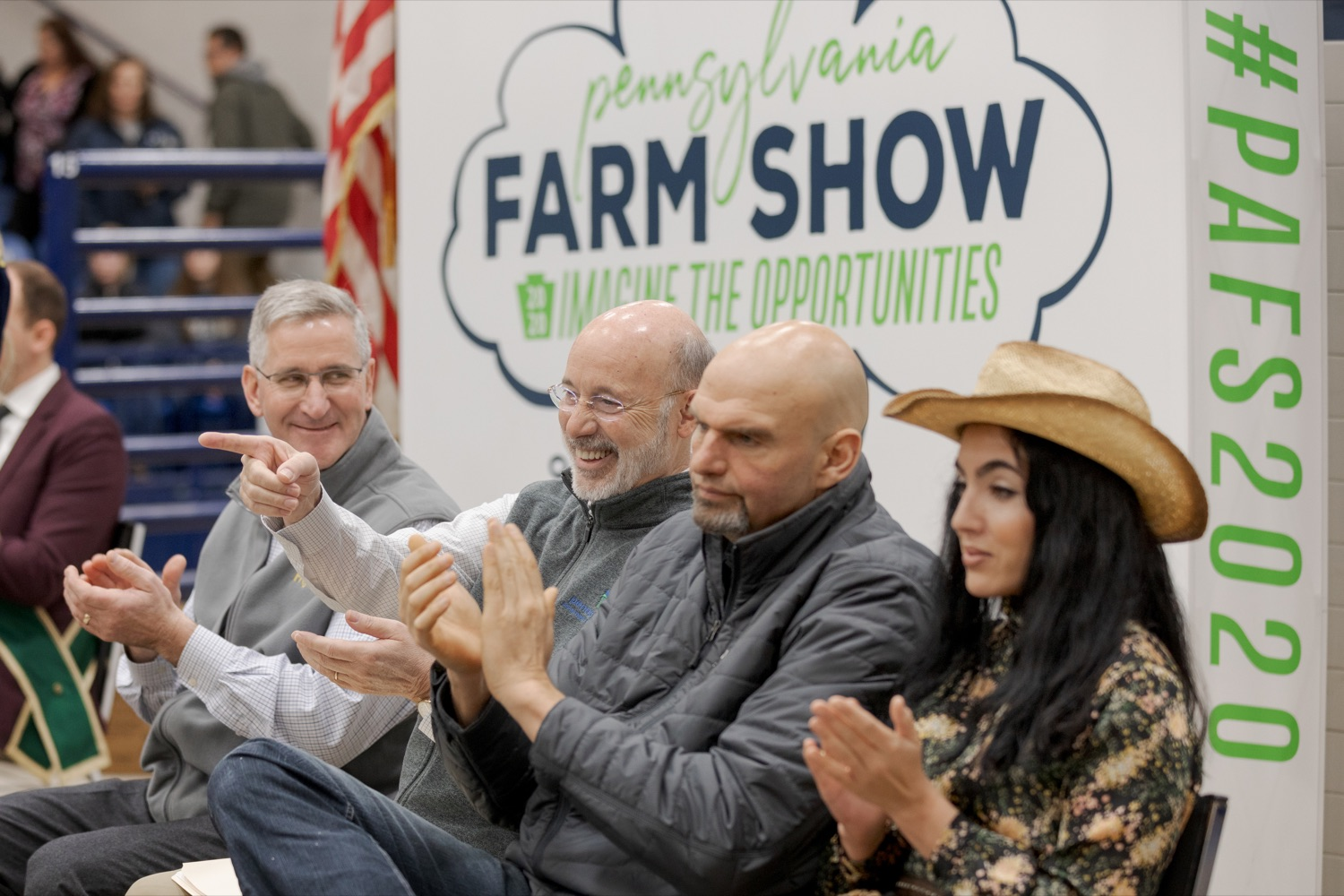 """<a href=""""https://filesource.wostreaming.net/commonwealthofpa/photo/17648_AGRIC_Opening_Ceremonies_NK_001.JPG"""" target=""""_blank"""">⇣Download Photo<br></a>From left; Pennsylvania Department of Agriculture Secretary Russell Redding; Pennsylvania Governor Tom Wolf; Pennsylvania Lt. Governor John Fetterman; and Gisele Fetterman, Pennsylvania's second lady, sit together during the kick-off of the 2020 Pennsylvania Farm Show on Saturday, January 4, 2020."""