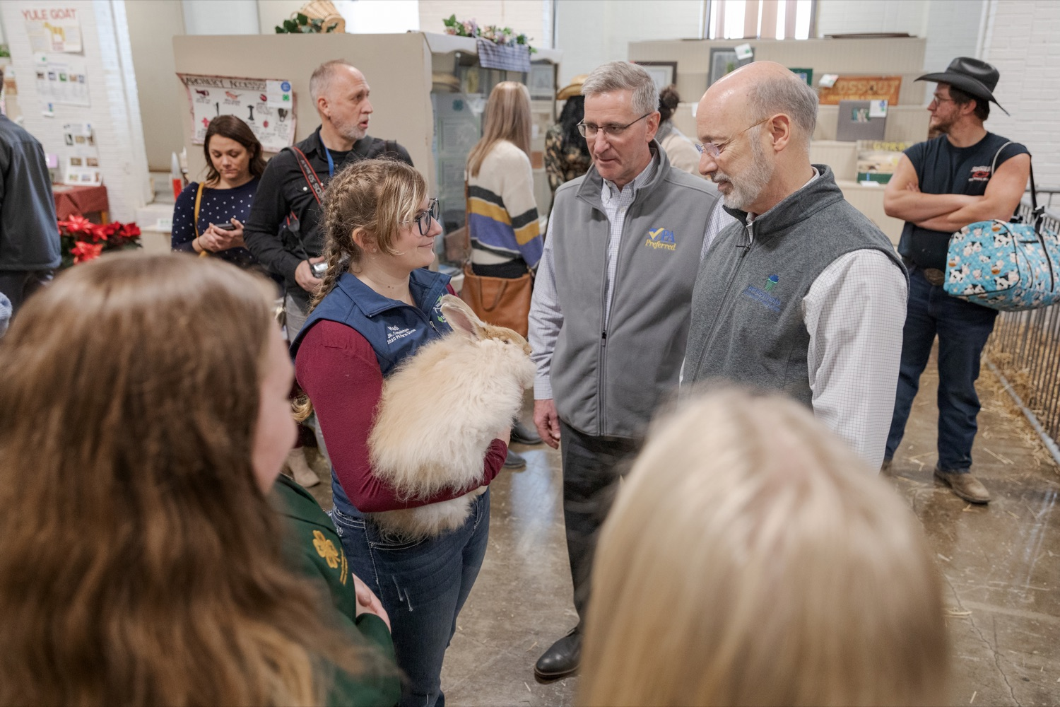 "<a href=""https://filesource.wostreaming.net/commonwealthofpa/photo/17648_AGRIC_Opening_Ceremonies_NK_016.JPG"" target=""_blank"">⇣ Download Photo<br></a>Pennsylvania Agriculture Secretary Russell Redding, center, and Pennsylvania Governor Tom Wolf, meet a rabbit, during the kick-off of the 2020 Pennsylvania Farm Show on Saturday, January 4, 2020."