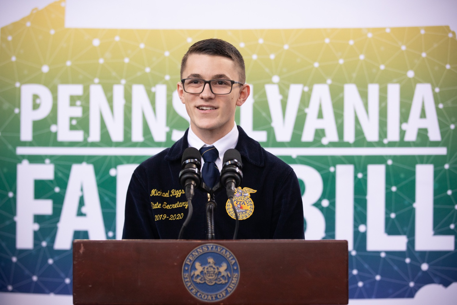 "<a href=""https://filesource.wostreaming.net/commonwealthofpa/photo/17649_agric_youth_grant_farm_bill_dz_006.jpg"" target=""_blank"">⇣ Download Photo<br></a>Michael Riggs, State Secretary Pennsylvania FFA, speaking at the announcement. Governor Tom Wolf today announced the approval of $500,000 in Ag and Youth Grants to fund 55 projects that will improve access to agriculture education in the commonwealth, with a goal of addressing the looming 75,000 workforce deficit Pennsylvanias agriculture industry faces in the coming decade. Harrisburg, PA  January 6, 2020"