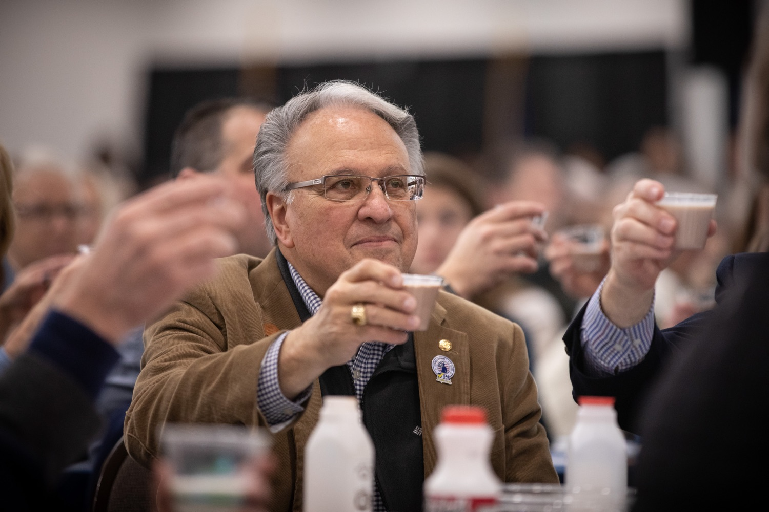 """<a href=""""https://filesource.wostreaming.net/commonwealthofpa/photo/17650_agric_public_officials_day_dz_002.jpg"""" target=""""_blank"""">⇣Download Photo<br></a>Rep. Eddie Day Pashinski  enjoying the Milk Toast at Public Officials Day.  Addressing nearly 800 public officials at the Pennsylvania Farm Show today, Agriculture Secretary Russell Redding announced the opening of the last grant program made possible by the 2019 PA Farm Bill. The $1 million Farm Vitality Grant Program aims to enhance the long-term health and vitality of Pennsylvanias family farms. Harrisburg, PA  January 08, 2020"""