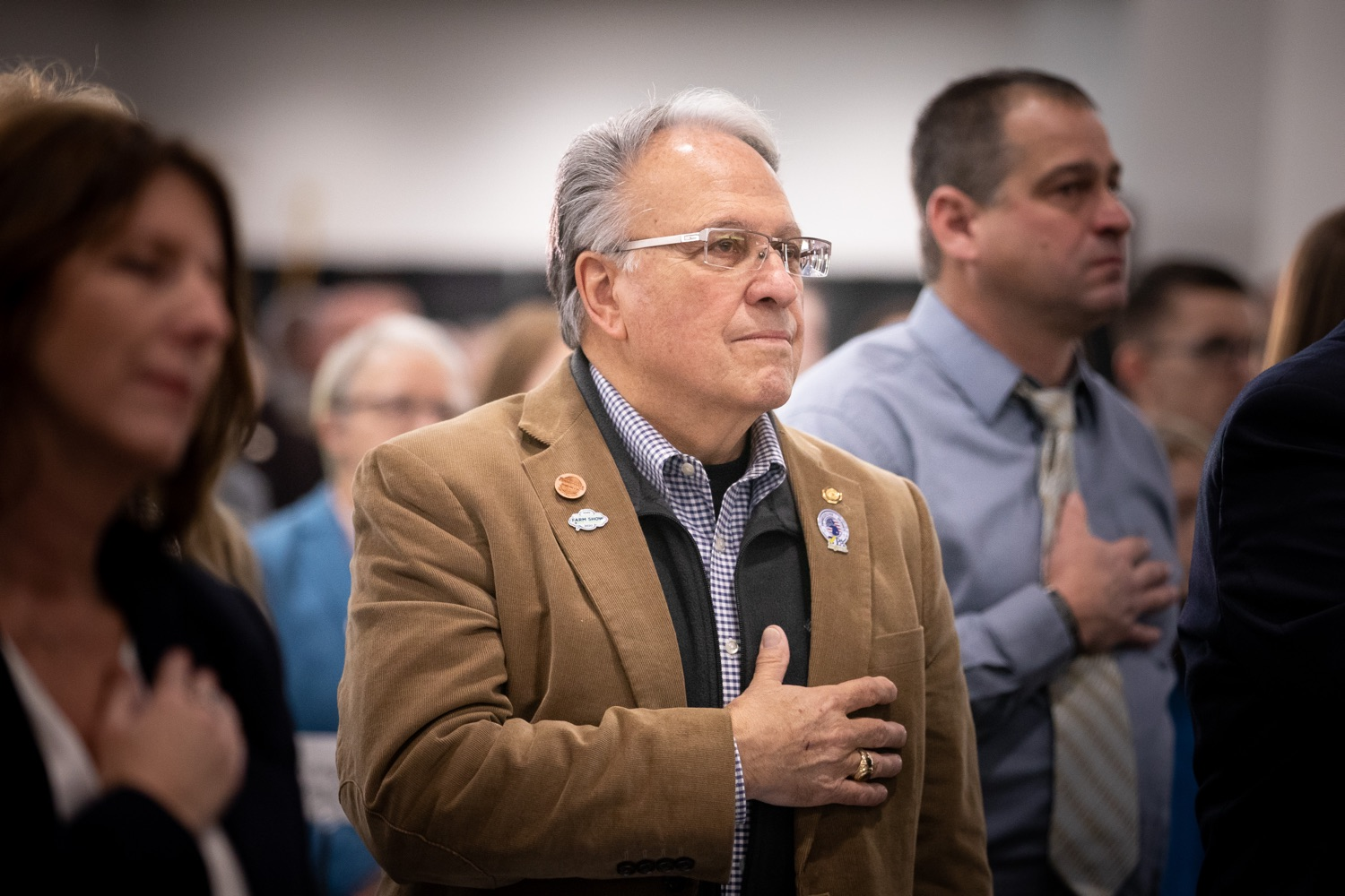 """<a href=""""https://filesource.wostreaming.net/commonwealthofpa/photo/17650_agric_public_officials_day_dz_007.jpg"""" target=""""_blank"""">⇣Download Photo<br></a>Rep. Eddie Day Pashinski Complex standing for the National Anthem at Public Officials Day. Addressing nearly 800 public officials at the Pennsylvania Farm Show today, Agriculture Secretary Russell Redding announced the opening of the last grant program made possible by the 2019 PA Farm Bill. The $1 million Farm Vitality Grant Program aims to enhance the long-term health and vitality of Pennsylvanias family farms. Harrisburg, PA  January 08, 2020"""