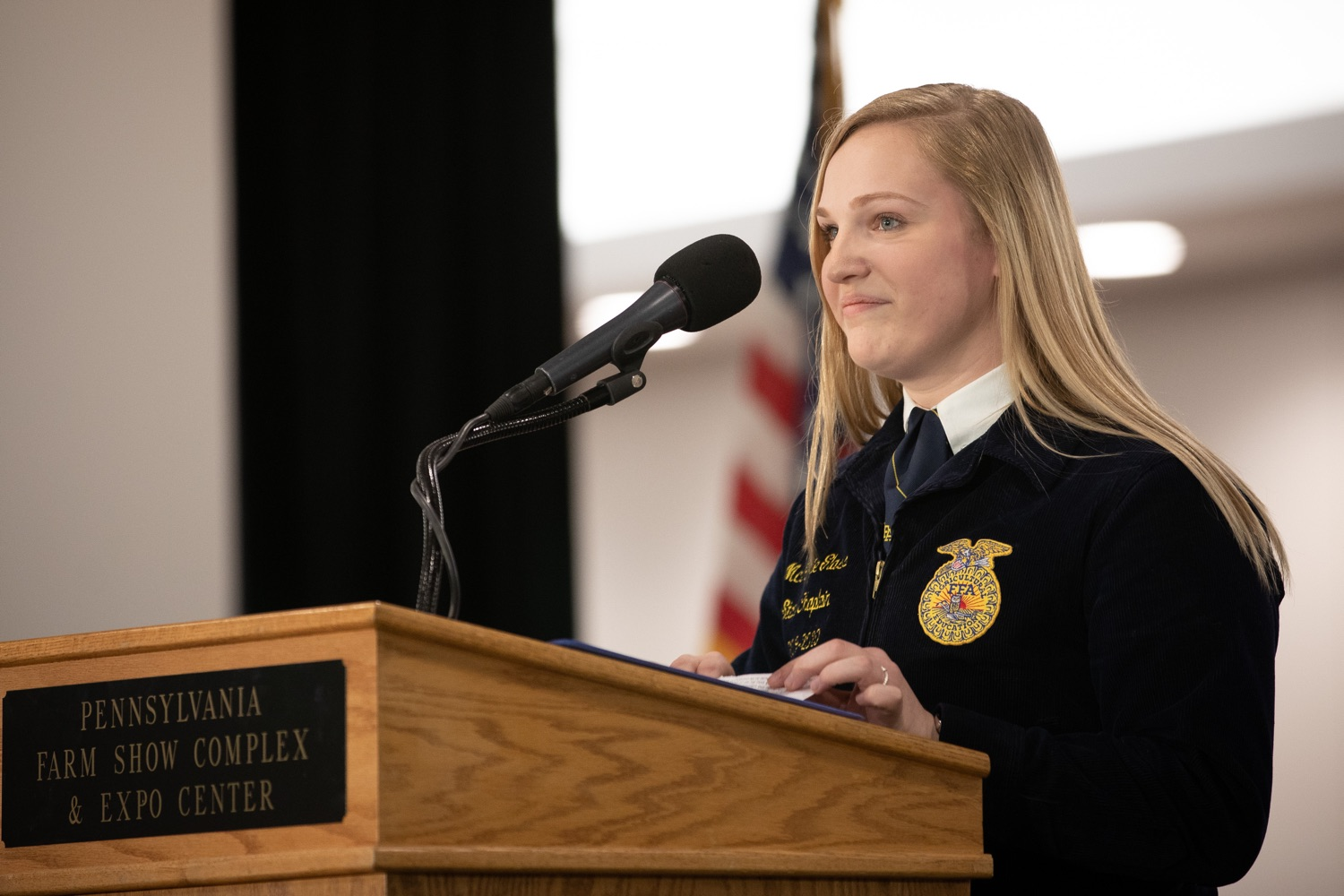 """<a href=""""https://filesource.wostreaming.net/commonwealthofpa/photo/17650_agric_public_officials_day_dz_013.jpg"""" target=""""_blank"""">⇣Download Photo<br></a>FAA Chaplain McKenzie Glass delivering the invocation at Public Officials Day.  Addressing nearly 800 public officials at the Pennsylvania Farm Show today, Agriculture Secretary Russell Redding announced the opening of the last grant program made possible by the 2019 PA Farm Bill. The $1 million Farm Vitality Grant Program aims to enhance the long-term health and vitality of Pennsylvanias family farms. Harrisburg, PA  January 08, 2020"""