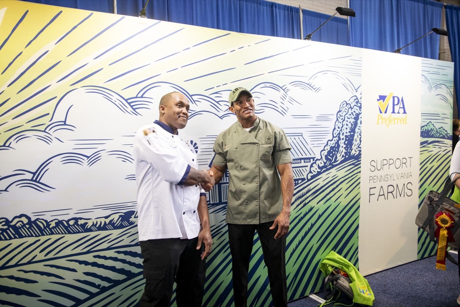 "<a href=""https://filesource.wostreaming.net/commonwealthofpa/photo/17651_AGRIC_ARMY_NAVY_COOKOFF_CZ_02.jpg"" target=""_blank"">⇣ Download Photo<br></a>Culinary Specialist First Class Marlon ONeil Haughton and Sergeant Pete O. Linton, Advanced Culinary NCO of the Army, shake hands following the 2020 Army vs. Navy Cook-Off in Harrisburg on January 9, 2020."