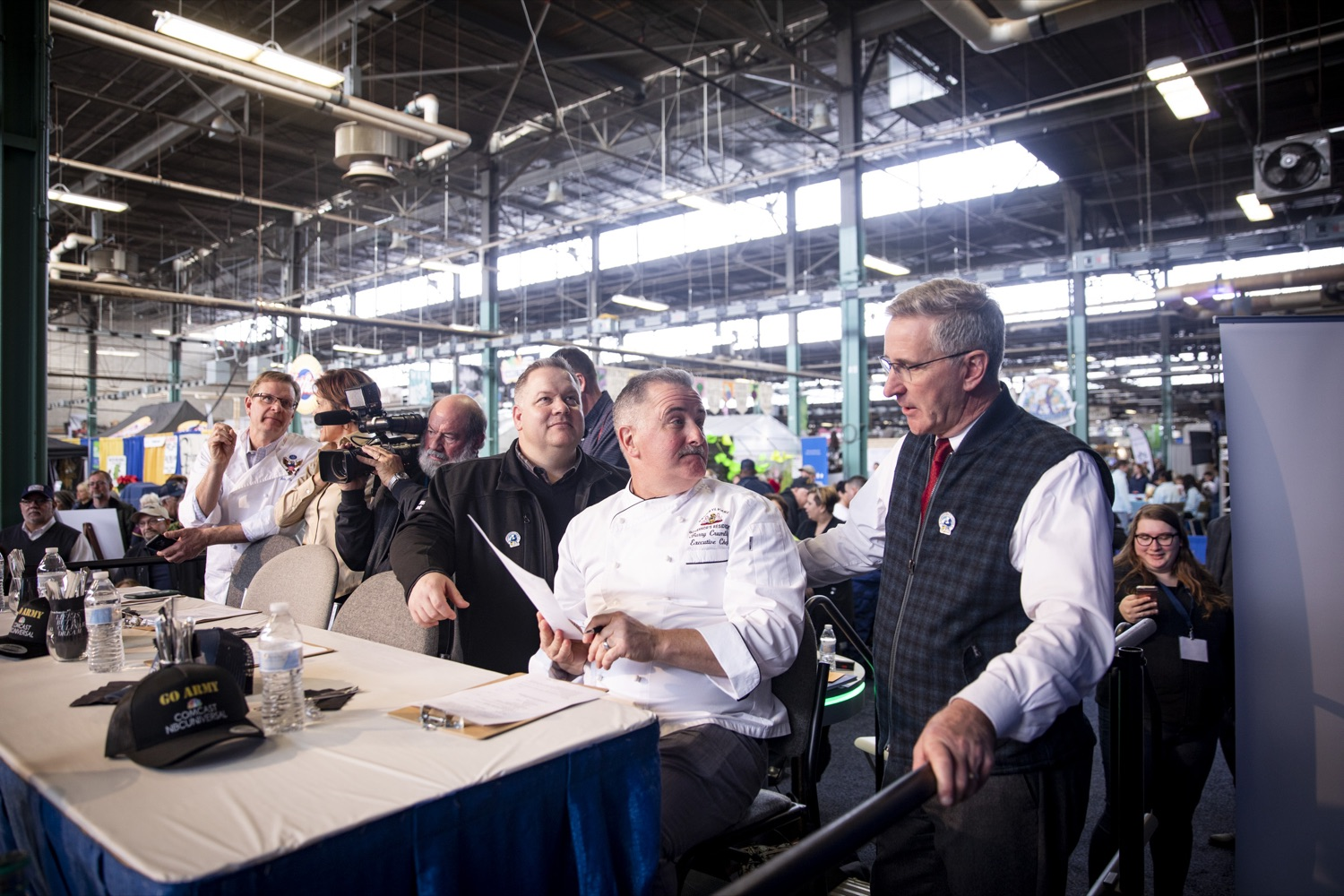 "<a href=""https://filesource.wostreaming.net/commonwealthofpa/photo/17651_AGRIC_ARMY_NAVY_COOKOFF_CZ_11.jpg"" target=""_blank"">⇣ Download Photo<br></a>Executive Chef at the PA Governors Residence Barry Crumlich shares notes from the judges panel with Secretary Russell Redding at the 2020 Army vs. Navy Cook-Off in Harrisburg on January 9, 2020."