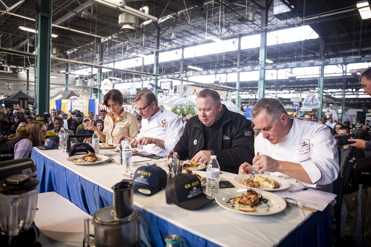 "<a href=""https://filesource.wostreaming.net/commonwealthofpa/photo/17651_AGRIC_ARMY_NAVY_COOKOFF_CZ_14.jpg"" target=""_blank"">⇣ Download Photo<br></a>(From Left to Right) Judges Sarah Dachos, John Moeller, Gregory Magee Jr., and Barry Crumlich taste dishes from competitors at the 2020 Army vs. Navy Cook-Off in Harrisburg on January 9, 2020."