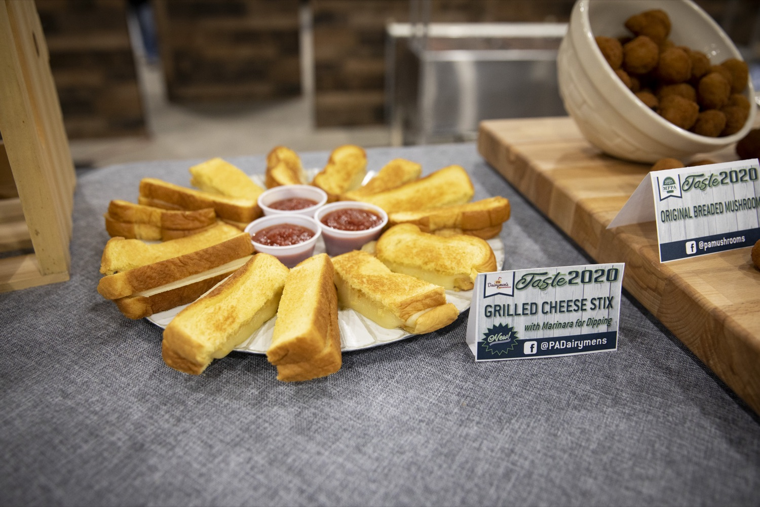 "<a href=""https://filesource.wostreaming.net/commonwealthofpa/photo/17658_FARM_SHOW_FIRST_TASTE_CZ_04.JPG"" target=""_blank"">⇣ Download Photo<br></a>The PA Dairymens Association introduces grilled cheese stix with marinara dipping sauce at the Pennsylvania Farm Show Food Court in Harrisburg on January 2, 2020."