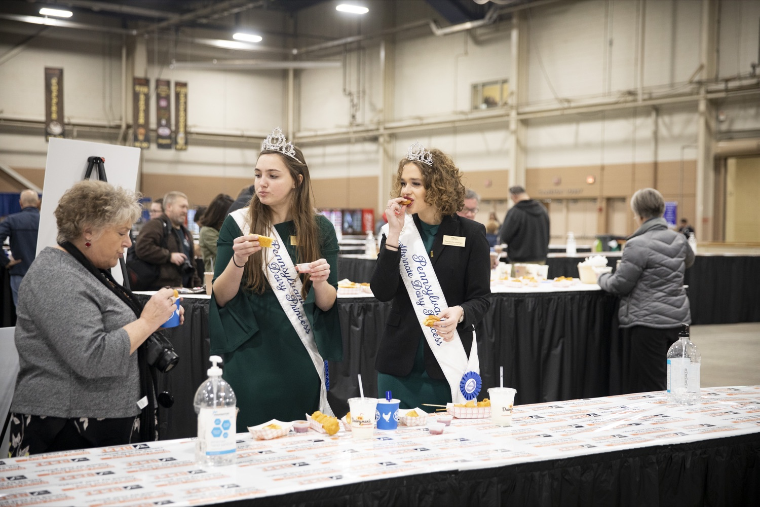 "<a href=""https://filesource.wostreaming.net/commonwealthofpa/photo/17658_FARM_SHOW_FIRST_TASTE_CZ_08.JPG"" target=""_blank"">⇣ Download Photo<br></a>Paige Peiffer and Denae Hershberger of Pennsylvania Dairy Princess & Promotion Services, sample milkshakes and treats from the PA Dairymens Association at the Pennsylvania Farm Show Food Court in Harrisburg on January 2, 2020."
