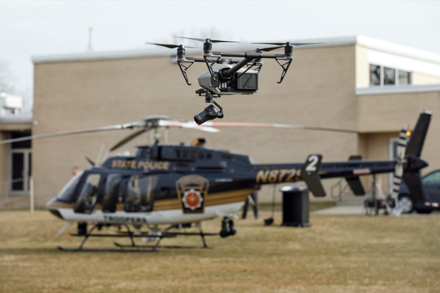 "<a href=""https://filesource.wostreaming.net/commonwealthofpa/photo/17706_DOH_Drone_Safety_NK_001.JPG"" target=""_blank"">⇣ Download Photo<br></a>A drone hovers in front of a Pennsylvania State Police helicopter before a press conference, which highlighted the danger drones pose to helicopters in emergency situations, at the Pennsylvania State Police Academy in Hershey on Friday, January 31, 2020."