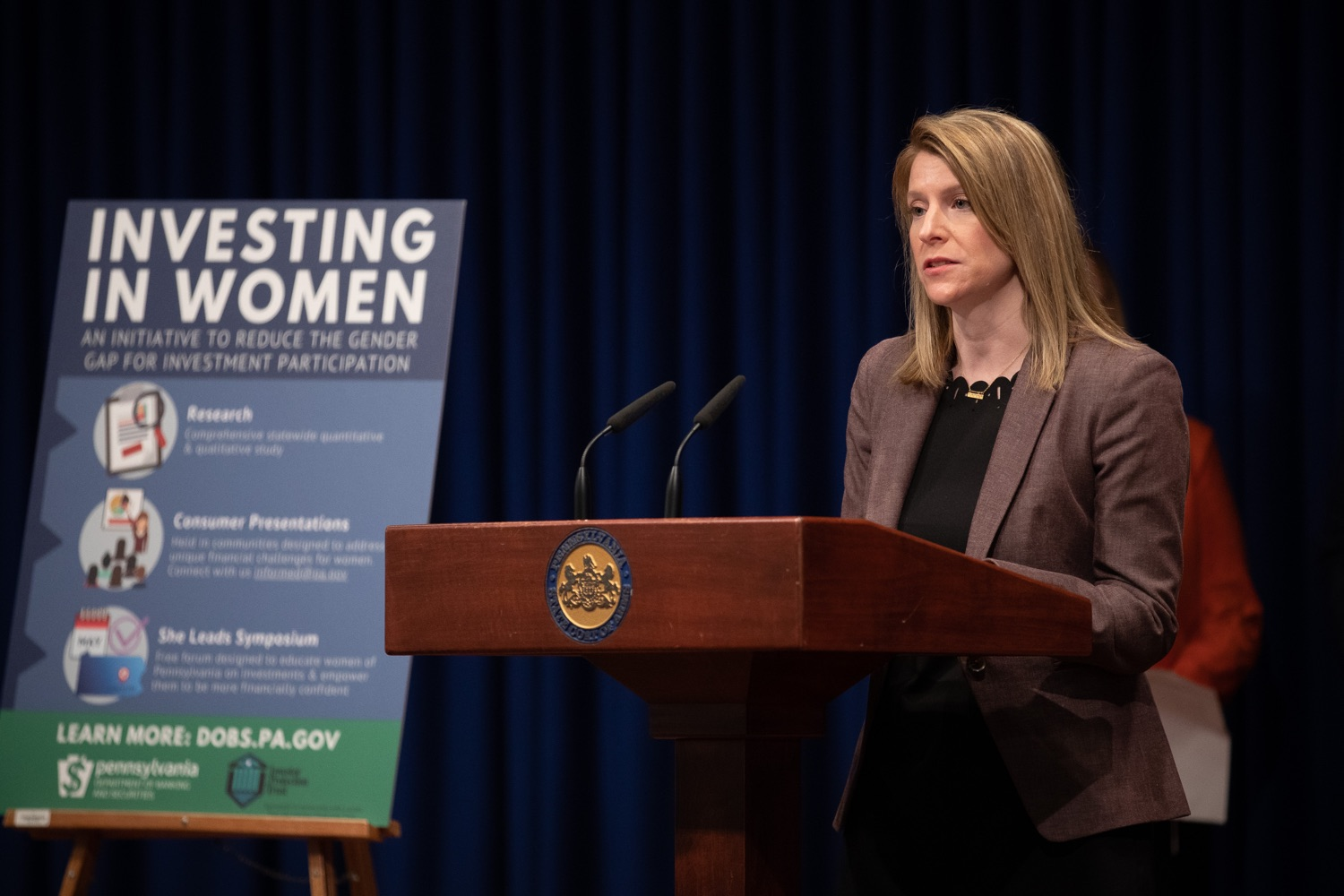 "<a href=""https://filesource.wostreaming.net/commonwealthofpa/photo/17725_dobs_investingwomen_dz_009.jpg"" target=""_blank"">⇣ Download Photo<br></a>Julie Bancroft, Chief Public Affairs Officer of the Pennsylvania Coalition Against Domestic Violence (PCADV) speaking at the announcement in the Capitol Media Center. Pennsylvania Department of Banking and Securities Secretary Robin L. Wiessmann today announced Investing in Women, an initiative aimed at providing women with important information about banking, credit, saving and investing, while offering practical resources to navigate their finances. The secretary was joined at a Capitol news conference by .Julie Bancroft, Chief Public Affairs Officer of the Pennsylvania Coalition Against Domestic Violence (PCADV).  .Harrisburg, PA - January 15, 2020."