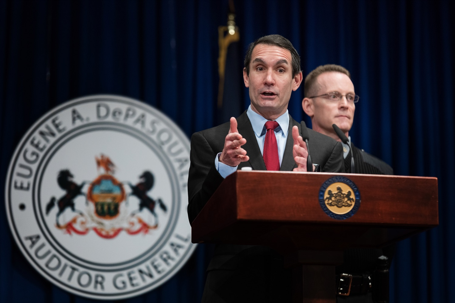 """<a href=""""https://filesource.wostreaming.net/commonwealthofpa/photo/17736_AUD_GEN_State_Police_Radios_NK_004.JPG"""" target=""""_blank"""">⇣Download Photo<br></a>Auditor General Eugene DePasquale speaks alongside Capt. Sean Georgia, director of PA State Police Radio and Information Services Division, inside the Capitol Media Center on Thursday, January 30, 2020. The press conference was held to announce the state auditor general's audit of the purchasing process for a new radio network designed to help Pennsylvania State Police and other emergency responders communicate with each other and keep the public safe."""