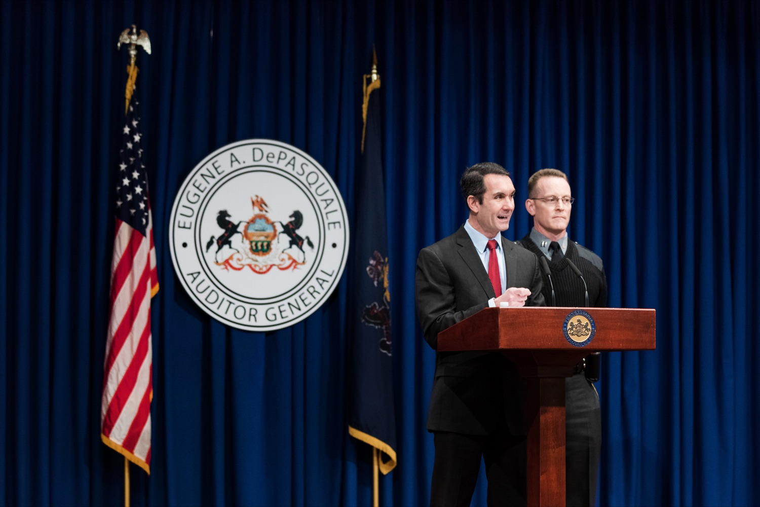 "<a href=""https://filesource.wostreaming.net/commonwealthofpa/photo/17736_AUD_GEN_State_Police_Radios_NK_007.JPG"" target=""_blank"">⇣ Download Photo<br></a>Auditor General Eugene DePasquale speaks alongside Capt. Sean Georgia, director of PA State Police Radio and Information Services Division, inside the Capitol Media Center on Thursday, January 30, 2020. The press conference was held to announce the state auditor general's audit of the purchasing process for a new radio network designed to help Pennsylvania State Police and other emergency responders communicate with each other and keep the public safe."