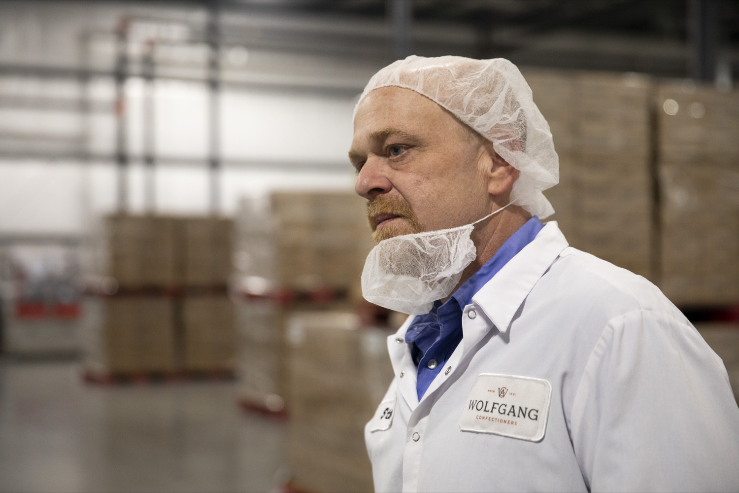 """<a href=""""https://filesource.wostreaming.net/commonwealthofpa/photo/17740_DCED_WOLFGANG_TOUR_CZ_02.JPG"""" target=""""_blank"""">⇣Download Photo<br></a>Steve Herbert, Plant Manager for Wolfgang Confectioners, gives a tour of the facility, which manufactures assorted chocolates and confections, in York County on February 13, 2020."""