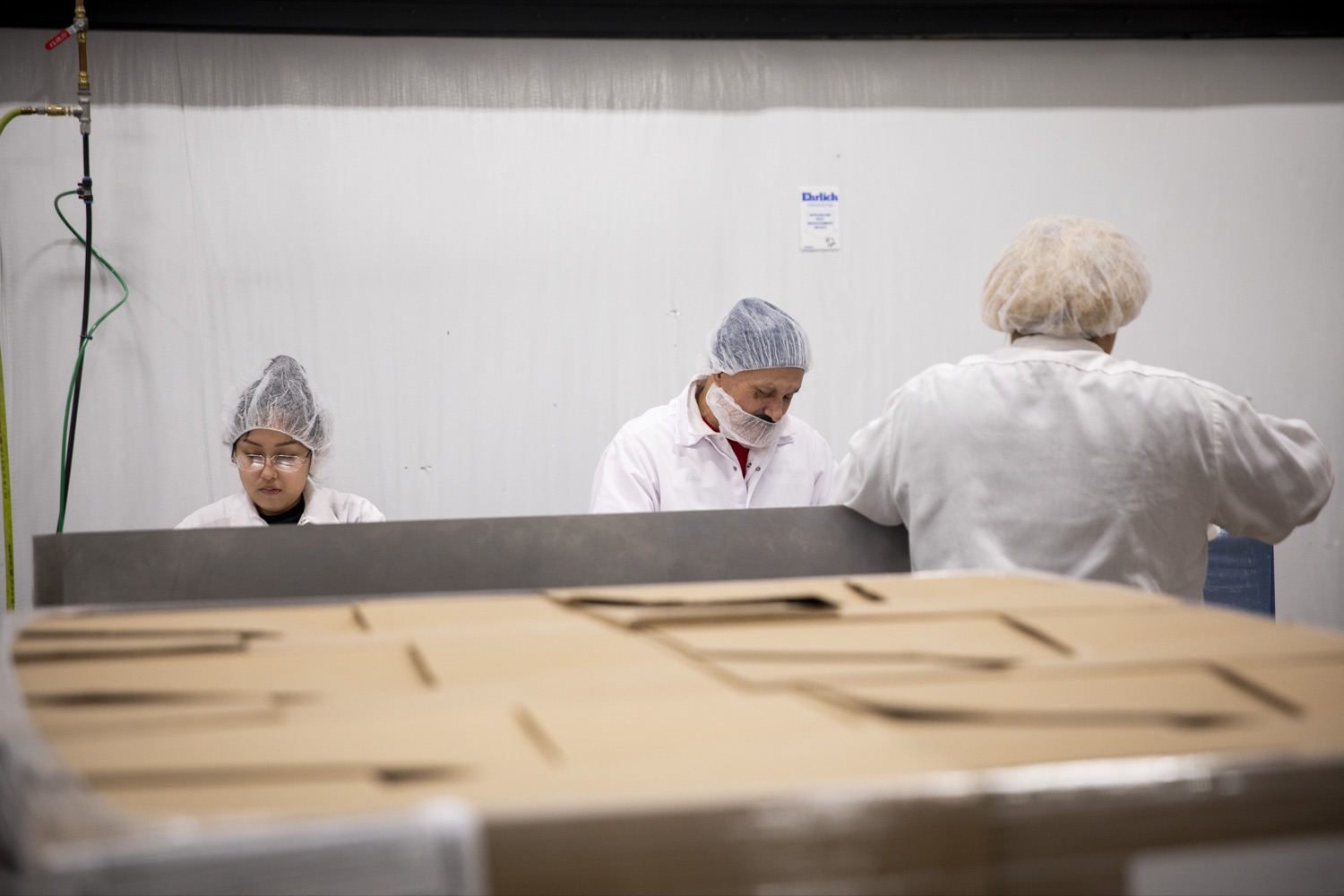 """<a href=""""https://filesource.wostreaming.net/commonwealthofpa/photo/17740_DCED_WOLFGANG_TOUR_CZ_04.JPG"""" target=""""_blank"""">⇣Download Photo<br></a>Employees at the Wolfgang Confectioners plant in York County prepare connections for shipment ahead of Valentine's Day, on February 13, 2020."""