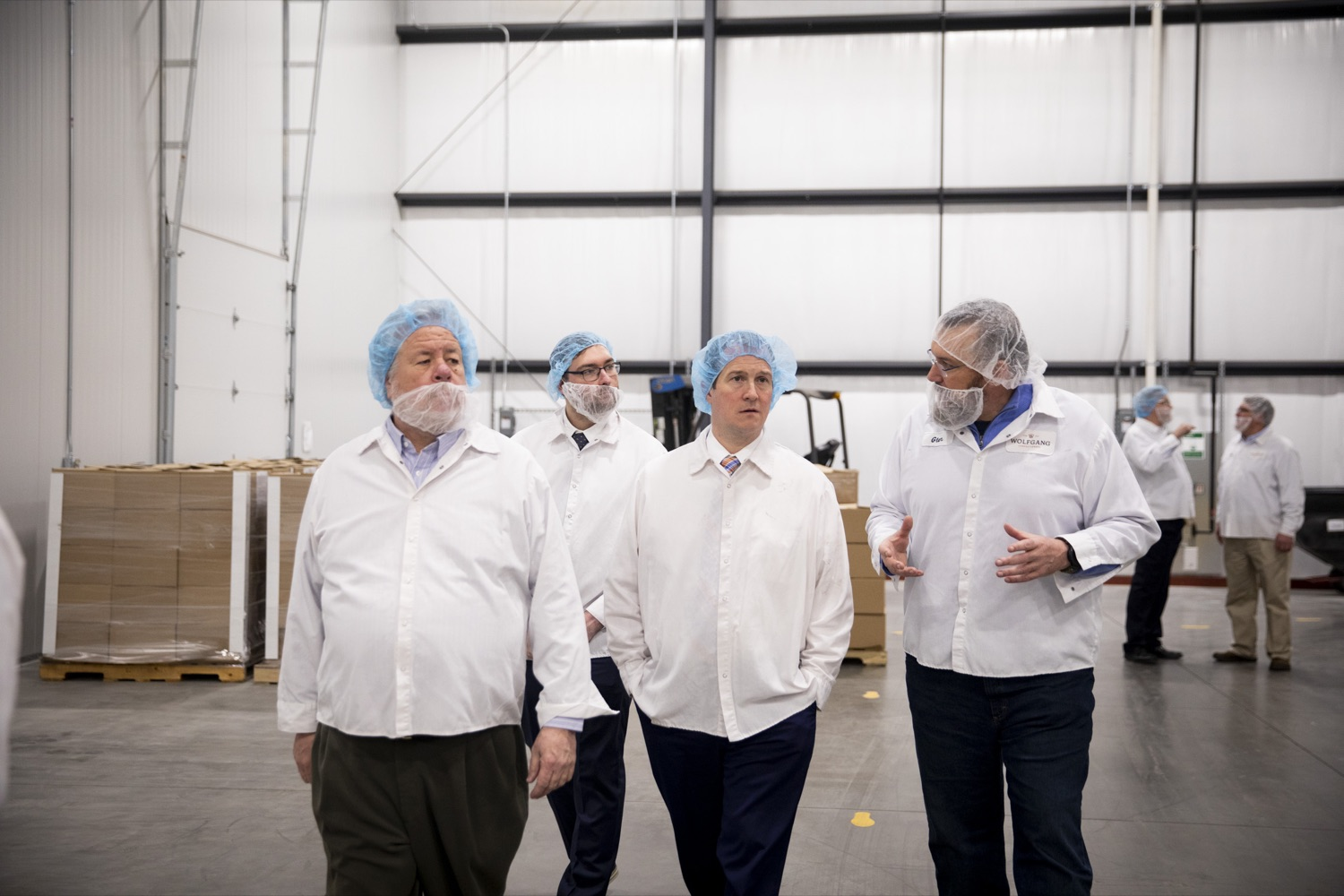 """<a href=""""https://filesource.wostreaming.net/commonwealthofpa/photo/17740_DCED_WOLFGANG_TOUR_CZ_05.JPG"""" target=""""_blank"""">⇣Download Photo<br></a>DCED Executive Deputy Secretary Neil Weaver (center right) tours the Wolfgang Confectioners plant in York County on February 13, 2020."""