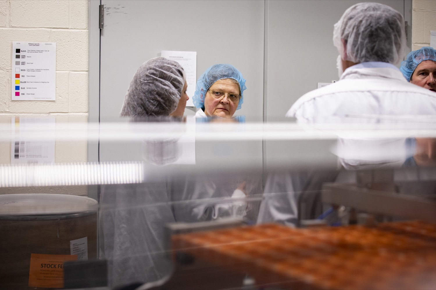 """<a href=""""https://filesource.wostreaming.net/commonwealthofpa/photo/17740_DCED_WOLFGANG_TOUR_CZ_14.JPG"""" target=""""_blank"""">⇣Download Photo<br></a>Department of Agriculture Deputy Secretary Cheryl Cook learns about Wolfgang Confectioners' facility and the growth it has achieved over the past few years, in York County on February 13, 2020."""