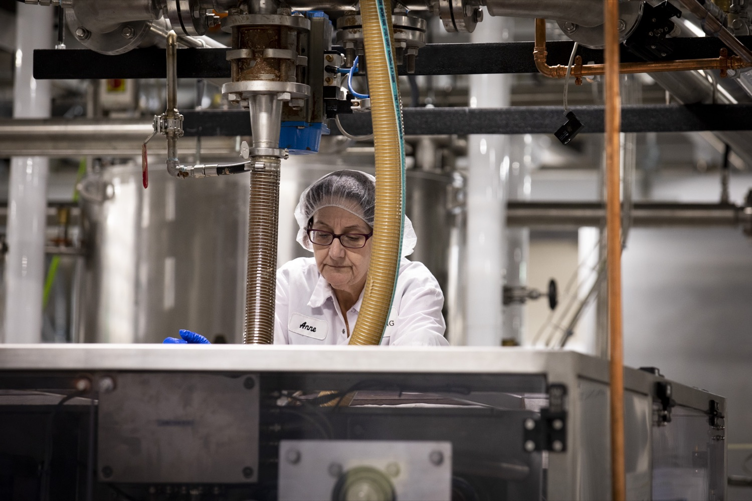 """<a href=""""https://filesource.wostreaming.net/commonwealthofpa/photo/17740_DCED_WOLFGANG_TOUR_CZ_19.JPG"""" target=""""_blank"""">⇣Download Photo<br></a>Anne Mounts of Wolfgang Confectioners processes ingredients for peanut butter candies, in York County on February 13, 2020."""