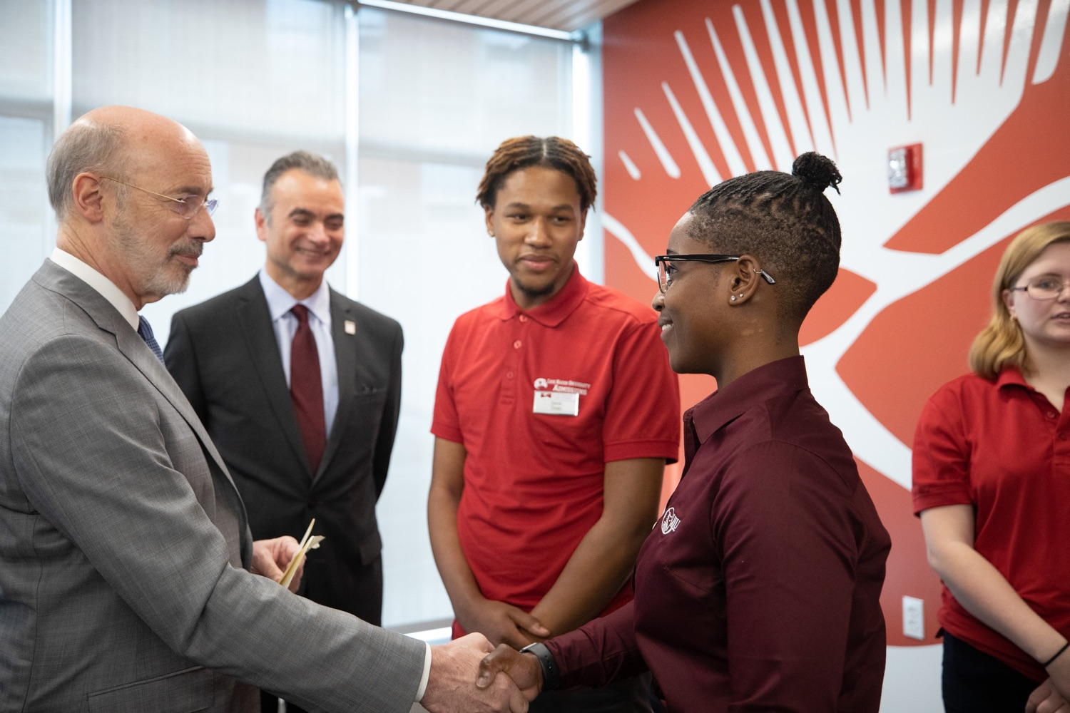 """<a href=""""https://filesource.wostreaming.net/commonwealthofpa/photo/17763_gov_highered_dz_006.jpg"""" target=""""_blank"""">⇣Download Photo<br></a>Governor Tom Wolf speaks to Lock Haven University student Mikaylah Johnson.  Governor Tom Wolf visited Lock Haven University today to launch a tour of the 14 state-owned universities and discuss his proposal to help thousands of low- and middle-class students afford their dream of a college education. Lock Haven, PA  February 12, 2020"""