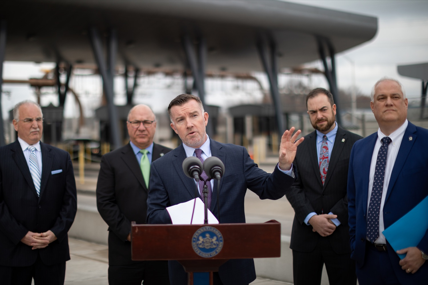 "<a href=""https://filesource.wostreaming.net/commonwealthofpa/photo/17799_Turnpike_Toll_Evasion_NK_001.JPG"" target=""_blank"">⇣ Download Photo<br></a>Mark Compton, Pennsylvania Turnpike Commission CEO, speaks during a press conference, which announced a partnership between the PA Turnpike Commission and Bucks County District Attorney to crack down on toll violators, or scofflaws, owing more than $2,000 in unpaid tolls, outside of the Turnpike Neshaminy Falls Mainline Toll Plaza on Wednesday, February 26, 2020."