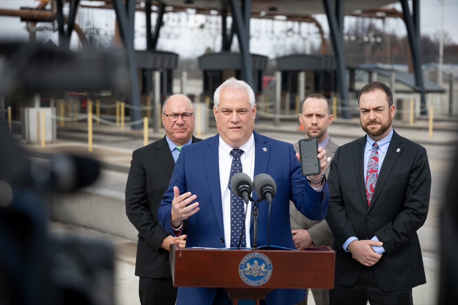 "<a href=""https://filesource.wostreaming.net/commonwealthofpa/photo/17799_Turnpike_Toll_Evasion_NK_009.JPG"" target=""_blank"">⇣ Download Photo<br></a>Matt Weintraub, Bucks County district attorney, speaks during a press conference, which announced a partnership between the PA Turnpike Commission and Bucks County District Attorney to crack down on toll violators, or scofflaws, owing more than $2,000 in unpaid tolls, outside of the Turnpike Neshaminy Falls Mainline Toll Plaza on Wednesday, February 26, 2020. Pictured in back (L-R); Pat Deon, Pennsylvania Turnpike commissioner; Phil Kulan, Bucks County detective; Dave Keightly Jr., Bucks County deputy district attorney."