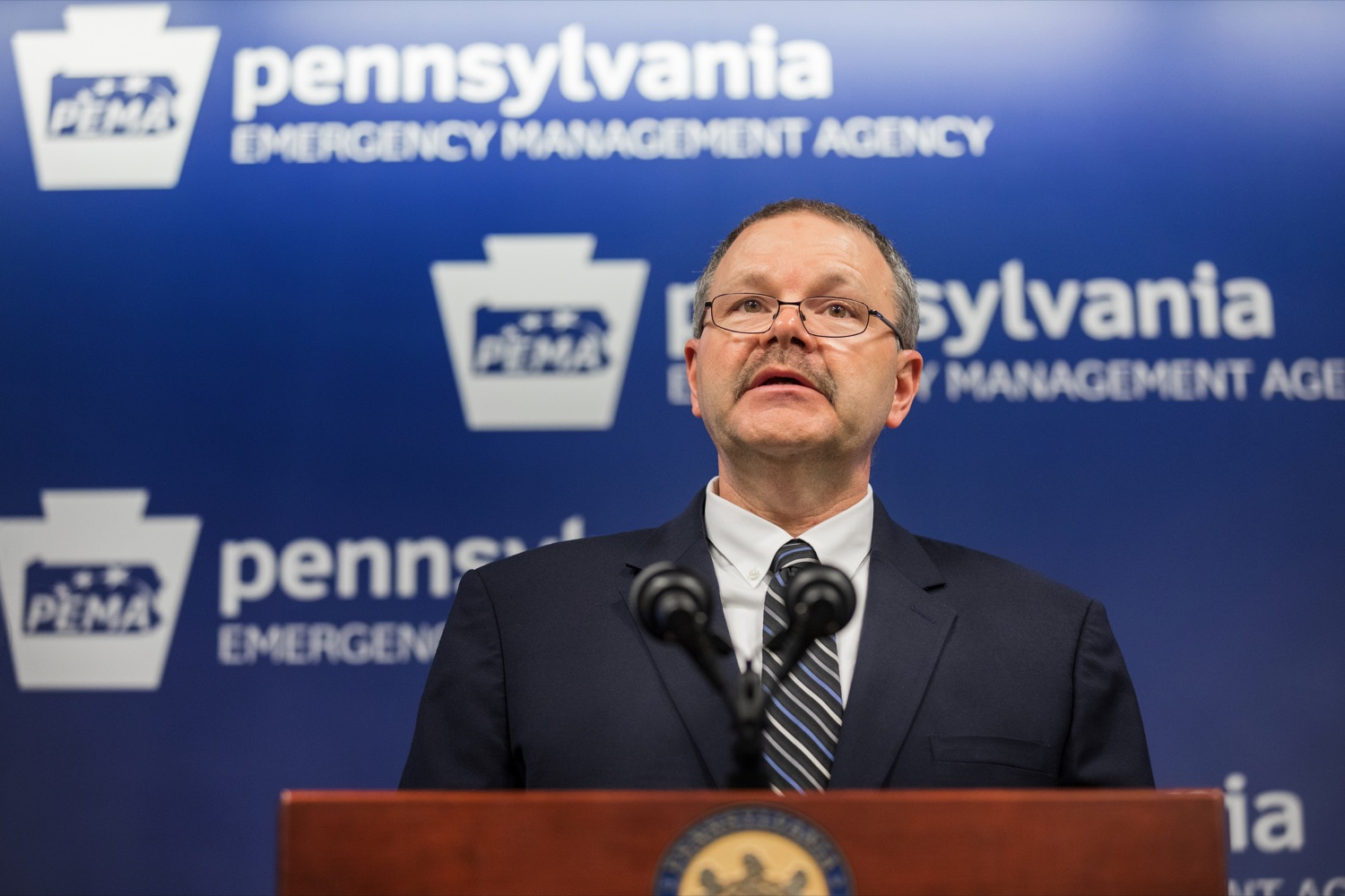 """<a href=""""https://filesource.wostreaming.net/commonwealthofpa/photo/17889_DOH_Corona_Update_96_NK_008.jpg"""" target=""""_blank"""">⇣Download Photo<br></a>Randy Padfield, director of the Pennsylvania Emergency Management Agency, speaks during a press conference, announcing the 96th presumptive positive case of 2019 Novel Coronavirus (COVID-19) in Pennsylvania, inside PEMA headquarters on Tuesday, March 17, 2020."""