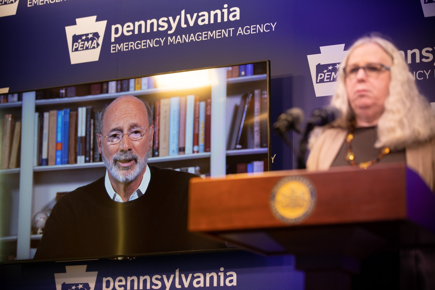 "<a href=""https://filesource.wostreaming.net/commonwealthofpa/photo/17897_gov_doh_update_dz_0010.JPG"" target=""_blank"">⇣ Download Photo<br></a>Governor Tom Wolf speaking by video feed while Secretary of Health Dr. Rachel Levine stands at the podium during the virtual press conference. The Pennsylvania Department of Health today confirmed as of 12:00 a.m., March 20, that there are 83 additional positive cases of COVID-19 reported, bringing the statewide total to 268. County-specific information and a statewide map are available here. All people are either in isolation at home or being treated at the hospital.  Harrisburg, PA- March 20, 2020"