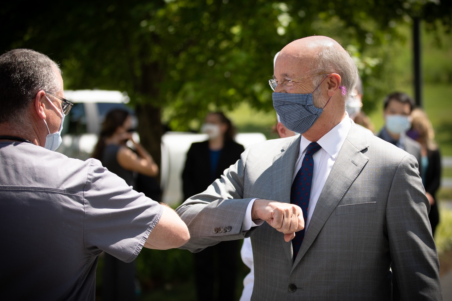 """<a href=""""https://filesource.wostreaming.net/commonwealthofpa/photo/18093_gov-healthcare_workers_dz_03.jpg"""" target=""""_blank"""">⇣Download Photo<br></a>Pennsylvania Governor Tom Wolf bumping elbows with medical workers during his visit to Milton S. Hershey Medical Center. As the commonwealth continues its measured, phased reopening and COVID-19 case counts continue to decline, Governor Tom Wolf visited Penn State Milton S. Hershey Medical Center today to thank staff and learn more about how the facility is handling the pandemic and preparing for a possible resurgence in the fall.  Harrisburg, PA  June 24, 2020"""