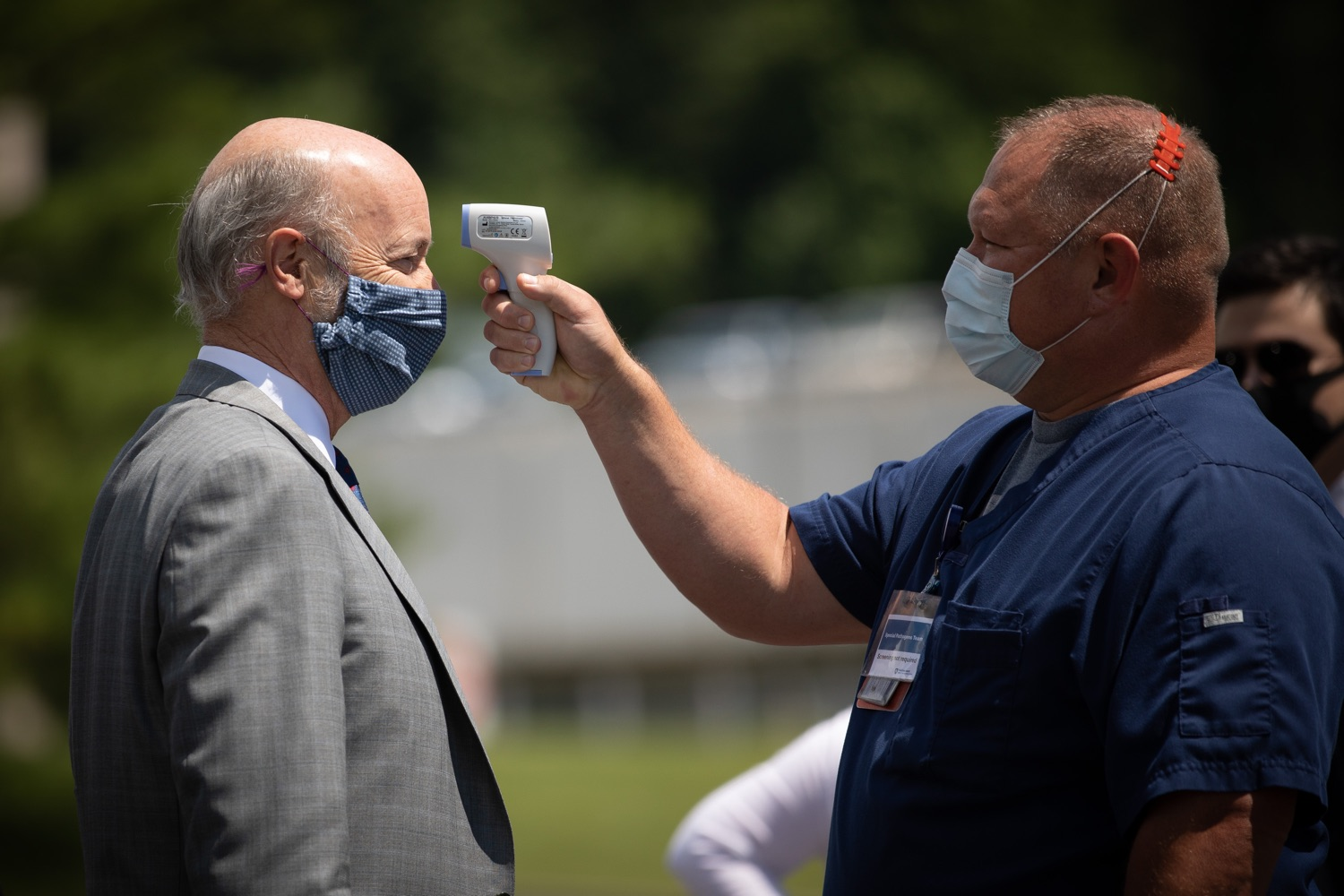 """<a href=""""https://filesource.wostreaming.net/commonwealthofpa/photo/18093_gov-healthcare_workers_dz_05.jpg"""" target=""""_blank"""">⇣Download Photo<br></a>Pennsylvania Governor Tom Wolf getting his temperature checked before his visit to Milton S. Hershey Medical Center. As the commonwealth continues its measured, phased reopening and COVID-19 case counts continue to decline, Governor Tom Wolf visited Penn State Milton S. Hershey Medical Center today to thank staff and learn more about how the facility is handling the pandemic and preparing for a possible resurgence in the fall.  Harrisburg, PA  June 24, 2020"""