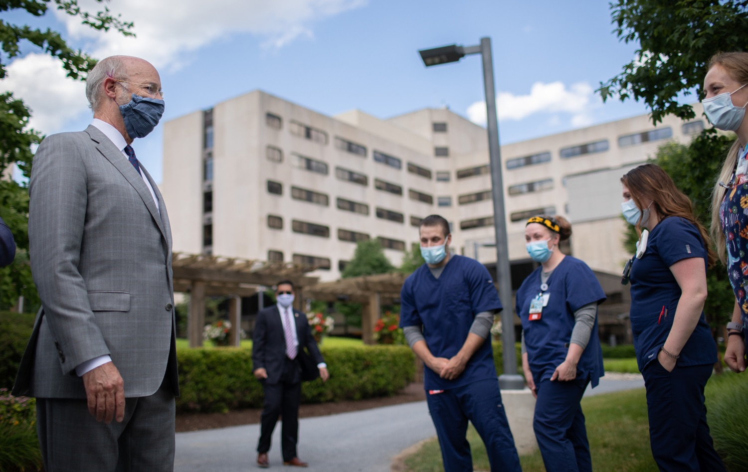 """<a href=""""https://filesource.wostreaming.net/commonwealthofpa/photo/18093_gov-healthcare_workers_dz_09.jpg"""" target=""""_blank"""">⇣Download Photo<br></a>Pennsylvania Governor Tom Wolf visits with medical workers during his visit to Milton S. Hershey Medical Center. As the commonwealth continues its measured, phased reopening and COVID-19 case counts continue to decline, Governor Tom Wolf visited Penn State Milton S. Hershey Medical Center today to thank staff and learn more about how the facility is handling the pandemic and preparing for a possible resurgence in the fall.  Harrisburg, PA  June 24, 2020"""