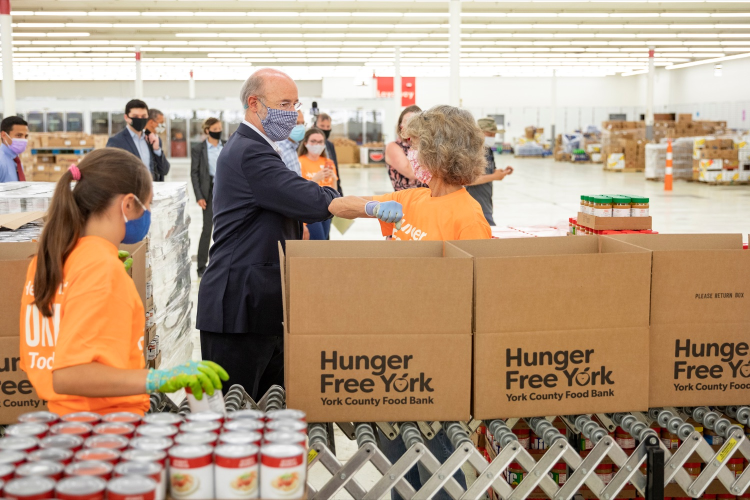 "<a href=""https://filesource.wostreaming.net/commonwealthofpa/photo/18095_GOV_Food_Bank_Volunteers_NK_003.jpg"" target=""_blank"">⇣ Download Photo<br></a>Governor Tom Wolf gives an elbow bump to York County Food Banks East York Emergency Food Hub volunteer Sharon Christ, of West Manchester Township, on Tuesday, June 23, 2020."