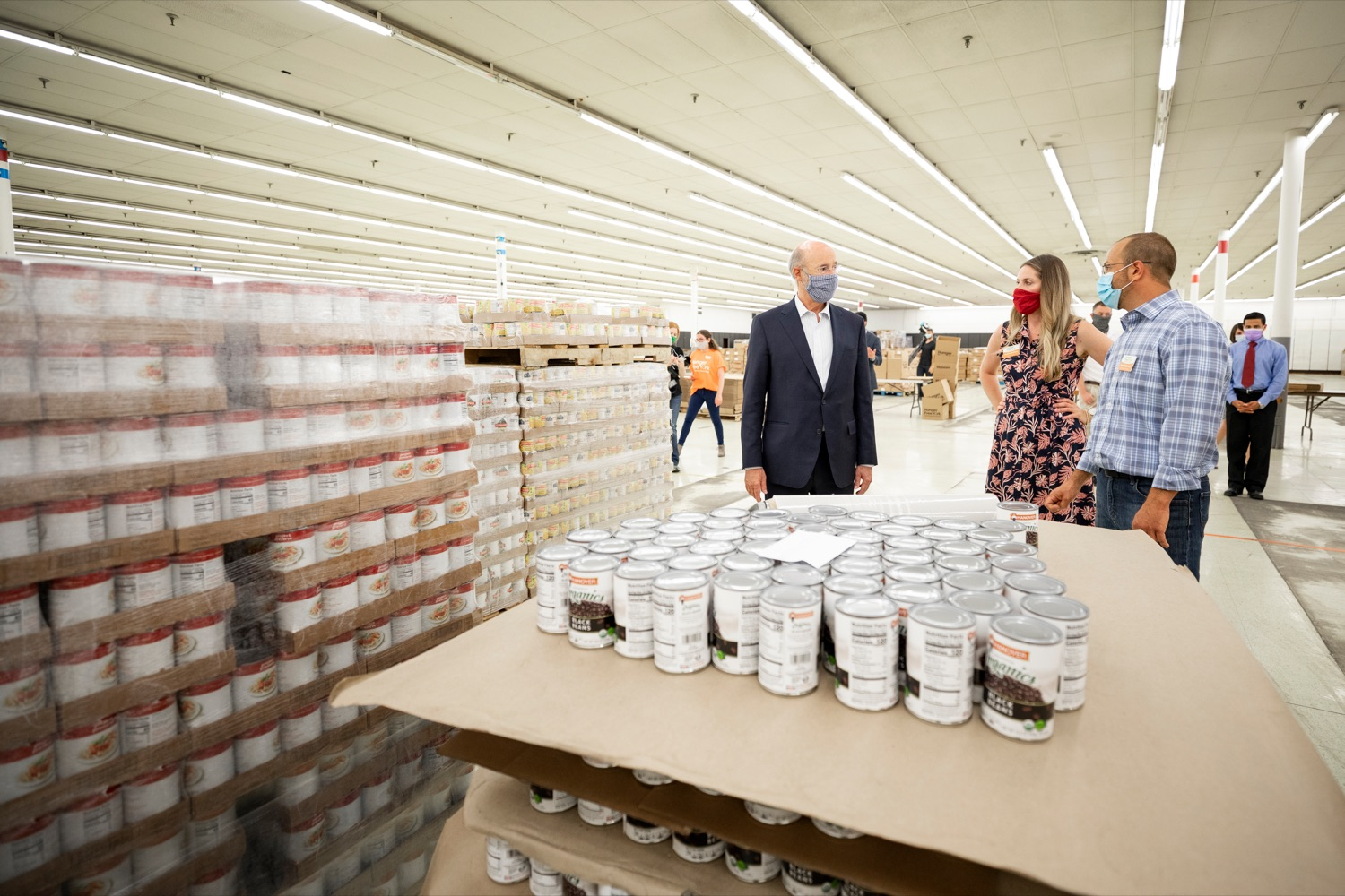 "<a href=""https://filesource.wostreaming.net/commonwealthofpa/photo/18095_GOV_Food_Bank_Volunteers_NK_006.jpg"" target=""_blank"">⇣ Download Photo<br></a>Governor Tom Wolf gets a tour of the York County Food Banks East York Emergency Food Hub, led by York County Food Bank's Jennifer Brillhart, president and CEO, center, and Zach Wolgemuth, director of programs, right, on Tuesday, June 23, 2020."