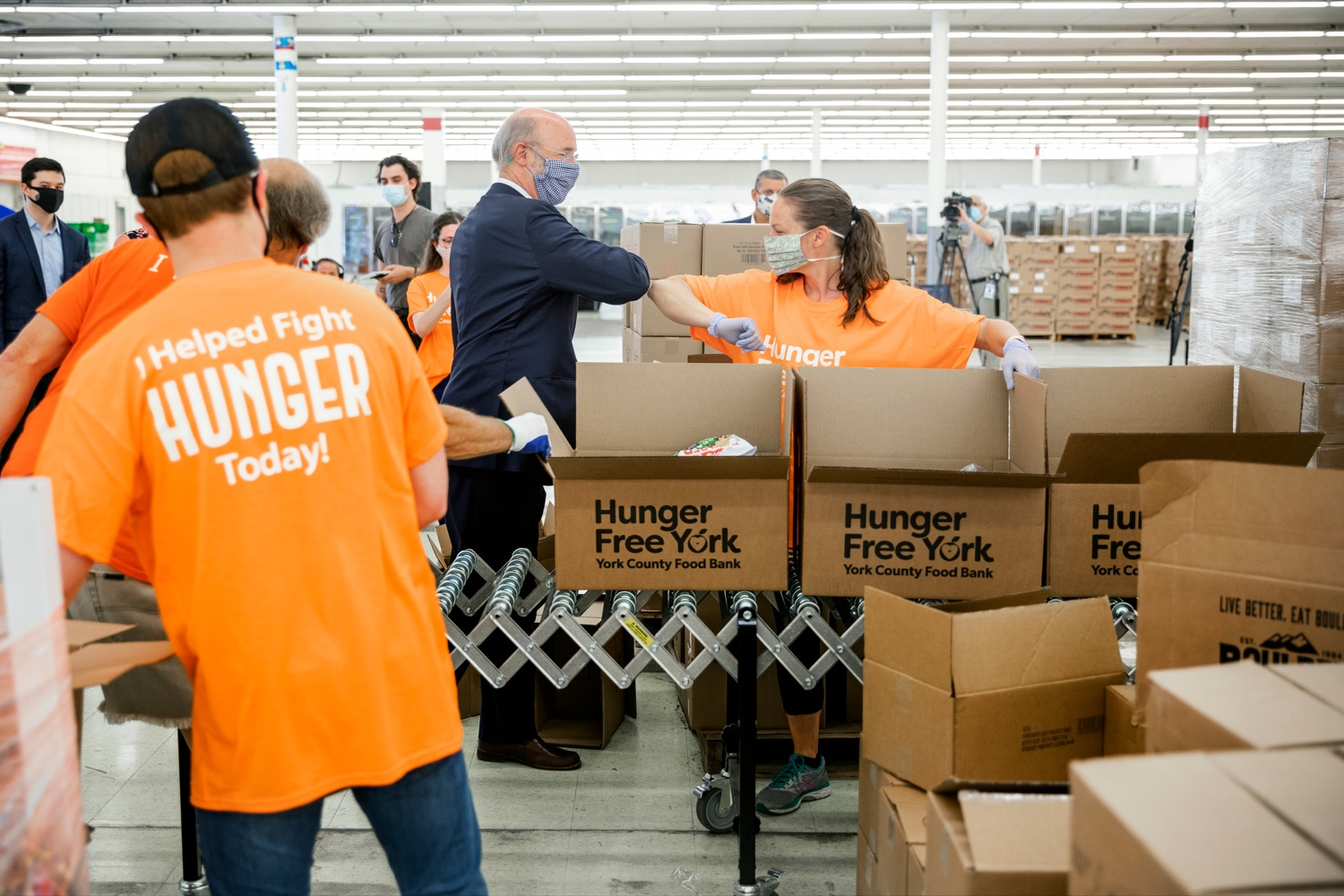 "<a href=""https://filesource.wostreaming.net/commonwealthofpa/photo/18095_GOV_Food_Bank_Volunteers_NK_010.jpg"" target=""_blank"">⇣ Download Photo<br></a>Governor Tom Wolf gives an elbow bump to York County Food Banks East York Emergency Food Hub volunteer Gracey Smith, of Springettsbury Township, on Tuesday, June 23, 2020. ,"