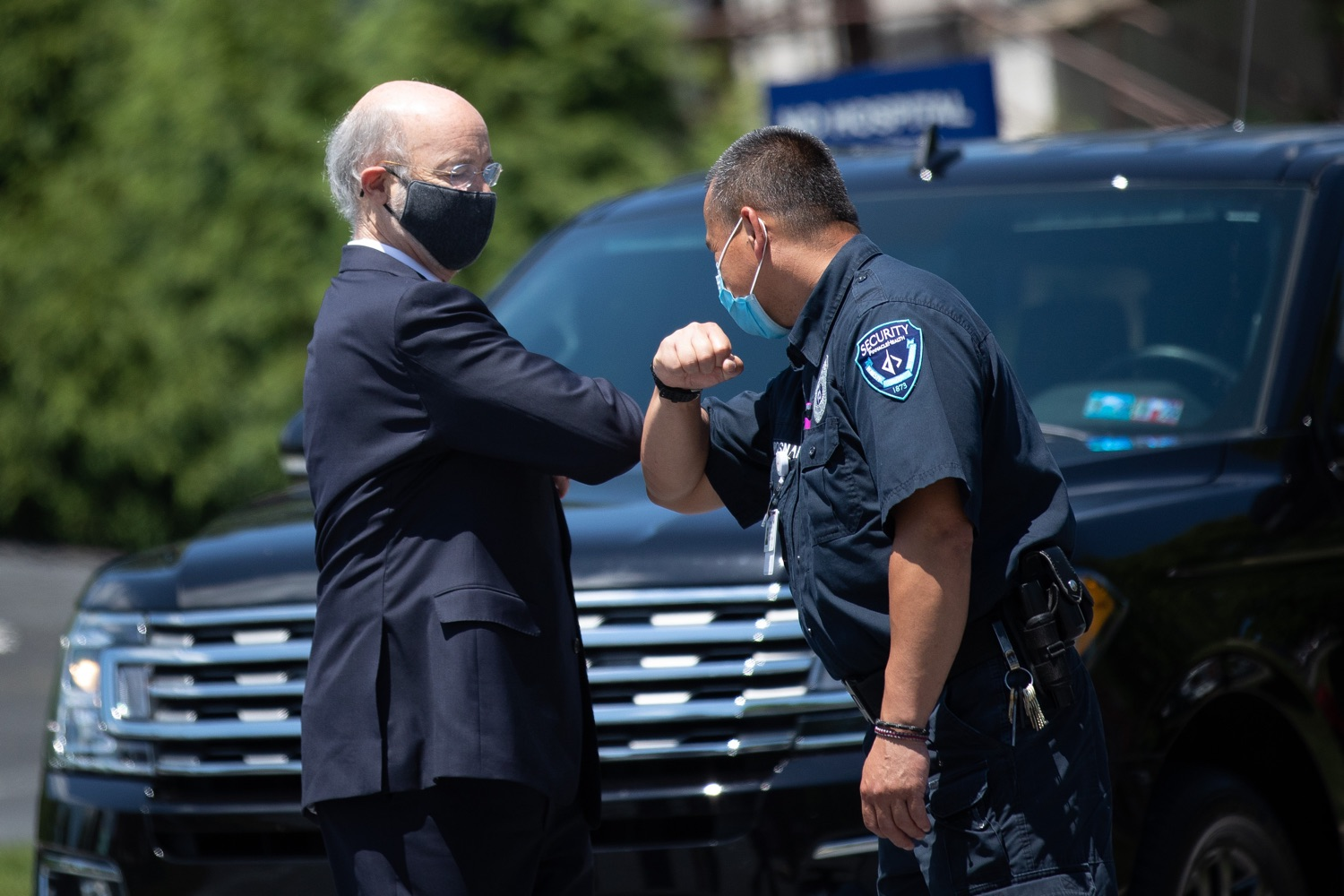 "<a href=""https://filesource.wostreaming.net/commonwealthofpa/photo/18101_gov_healthcare_dz_12.jpg"" target=""_blank"">⇣ Download Photo<br></a>Pennsylvania Governor Tom Wolf greeting security before speaking at UPMC Pinnacle Community Osteopathic. As health care professionals work the front lines of the COVID-19 pandemic and the commonwealth continues to emphasize the importance of mask-wearing and social distancing to protect all, Governor Tom Wolf today visited UPMC Pinnacle Community Osteopathic Hospital in Harrisburg to thank staff and stress why mask-wearing is a necessary requirement to fight the spread of COVID-19.    Harrisburg, PA  June 29, 2020"