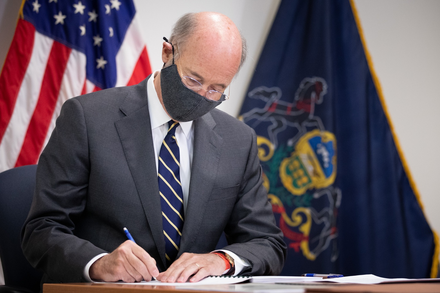 "<a href=""https://filesource.wostreaming.net/commonwealthofpa/photo/18141_gov_sb637_bill_signing_dz_01.jpg"" target=""_blank"">⇣ Download Photo<br></a>Pennsylvania Governor Tom Wolf signs a bill.  Building on his criminal justice reforms and fulfilling a recommendation to modernize job licensing, Governor Tom Wolf today signed Senate Bill 637, which removes outdated licensing barriers so skilled workers with criminal records can get a second chance and start good careers. The governor has advocated for sweeping changes to the licensing process for years. Harrisburg, PA  July 1, 2020"