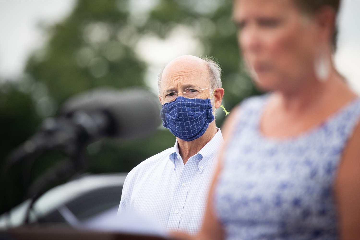 """<a href=""""https://filesource.wostreaming.net/commonwealthofpa/photo/18166_gov_cares_act_dz_12.jpg"""" target=""""_blank"""">⇣Download Photo<br></a>Pennsylvania Governor Tom Wolf listening to speakers at the announcement.  Today, Governor Tom Wolf announced the availability of $50 million in grant funding to help employers provide hazard pay to employees in life-sustaining occupations during the COVID-19 pandemic. Hazard pay is intended to keep front-line employees working in vital industry sectors across Pennsylvania.  Harrisburg, PA  July 16, 2020"""