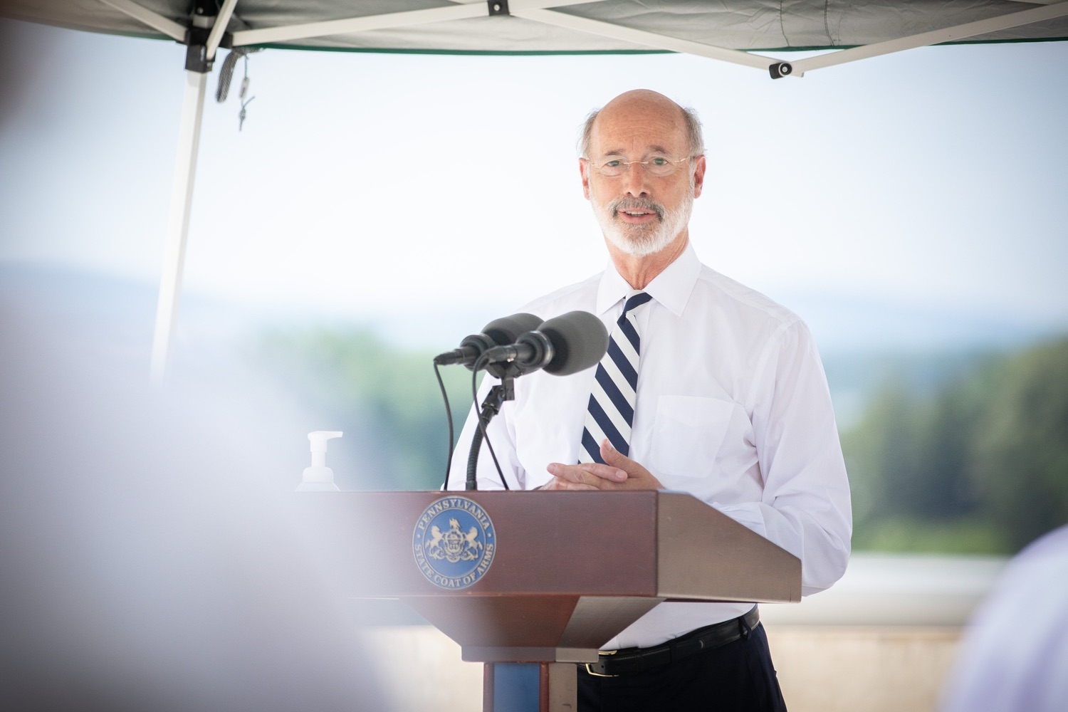 """<a href=""""https://filesource.wostreaming.net/commonwealthofpa/photo/18173_gov_wellspan_hospital_dz_04.jpg"""" target=""""_blank"""">⇣Download Photo<br></a>Pennsylvania governor Tom Wolf speaking to the press.  With a recent rise in COVID cases and subsequent additional targeted mitigation efforts put in place, Governor Tom Wolf today visited WellSpan York Hospital to thank staff and emphasize why mask-wearing and social distancing are necessary and effective to fight the spread of COVID-19.  Harrisburg, PA  July 21, 2020"""