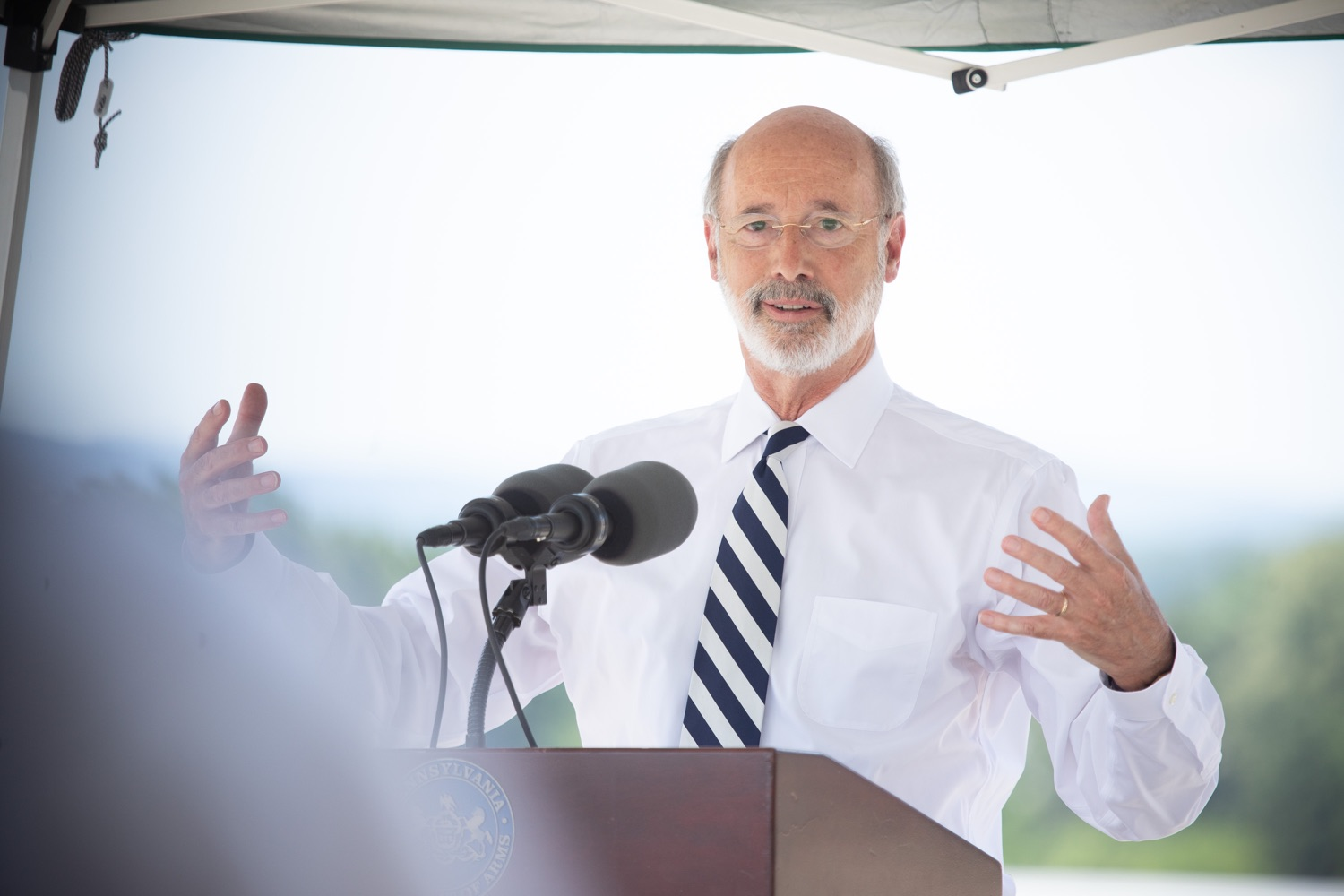 """<a href=""""https://filesource.wostreaming.net/commonwealthofpa/photo/18173_gov_wellspan_hospital_dz_09.jpg"""" target=""""_blank"""">⇣Download Photo<br></a>Pennsylvania governor Tom Wolf speaking to the press.  With a recent rise in COVID cases and subsequent additional targeted mitigation efforts put in place, Governor Tom Wolf today visited WellSpan York Hospital to thank staff and emphasize why mask-wearing and social distancing are necessary and effective to fight the spread of COVID-19.  Harrisburg, PA  July 21, 2020"""