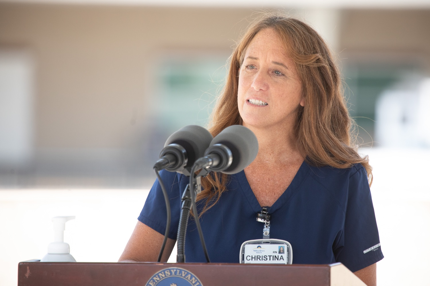 """<a href=""""https://filesource.wostreaming.net/commonwealthofpa/photo/18173_gov_wellspan_hospital_dz_10.jpg"""" target=""""_blank"""">⇣Download Photo<br></a>WellSpan cardiac ICU nurse, Christina Hansen speaking to the press.  With a recent rise in COVID cases and subsequent additional targeted mitigation efforts put in place, Governor Tom Wolf today visited WellSpan York Hospital to thank staff and emphasize why mask-wearing and social distancing are necessary and effective to fight the spread of COVID-19.  Harrisburg, PA  July 21, 2020"""