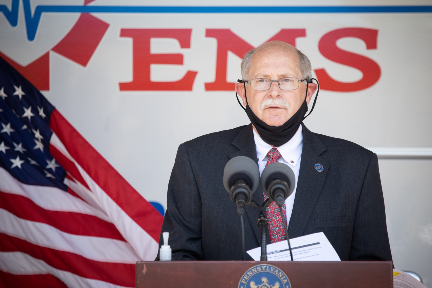 "<a href=""https://filesource.wostreaming.net/commonwealthofpa/photo/18180_gov_first_responders_dz_007.jpg"" target=""_blank"">⇣ Download Photo<br></a>Pennsylvania State Fire Commissioner, Bruce Trego speaking to the press. Governor Tom Wolf visited the Millersville location of Lancaster EMS today to thank first responders and learn about how they are adapting their critical work during the states response to the COVID-19 pandemic.  Millersville, PA  July 30, 2020"
