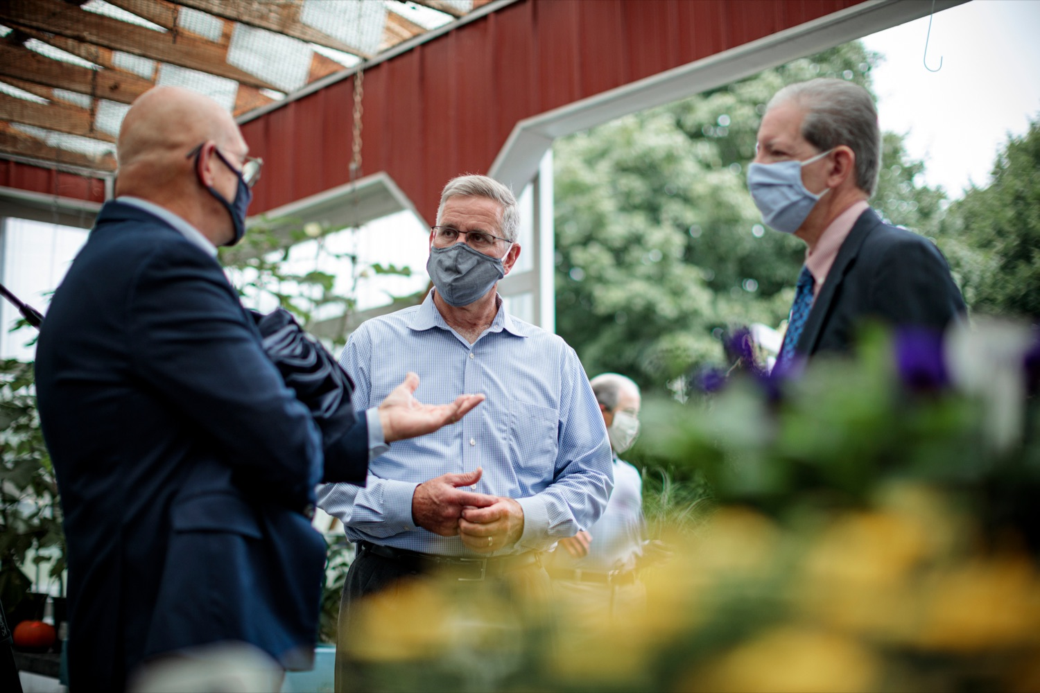 "<a href=""https://filesource.wostreaming.net/commonwealthofpa/photo/18235_AGRIC_SLF_NK_001.jpg"" target=""_blank"">⇣ Download Photo<br></a>Agriculture Secretary Russell Redding, center, speaks with Rick Roush, Penn State dean of agriculture, left, and Carlos Martinez, executive director of field operations for the USDA, right, at Cherry Hill Orchard Outlet and Garden Center in Lancaster on Thursday, September 10, 2020."