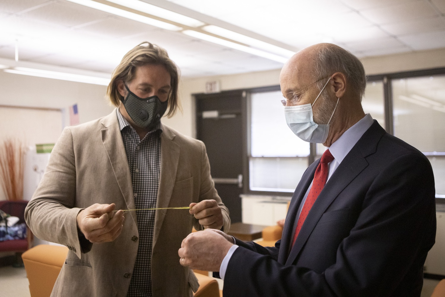 """<a href=""""https://filesource.wostreaming.net/commonwealthofpa/photo/18310_gov_adult_use_cannabis_dz_004.jpg"""" target=""""_blank"""">⇣Download Photo<br></a>Eric Titus White, hemp farmer showing Governor Tom Wolf a cutting of industrial hemp.  Governor Tom Wolf visited The Mountain Center in Tobyhanna, Monroe County today to talk about the economic growth potential and restorative justice benefits of legalizing adult-use cannabis, something the state General Assembly has not yet done despite multiple requests from the governor and Lieutenant Governor John Fetterman to take up legislation this fall.  Tobyhanna, PA  October 13, 2020"""