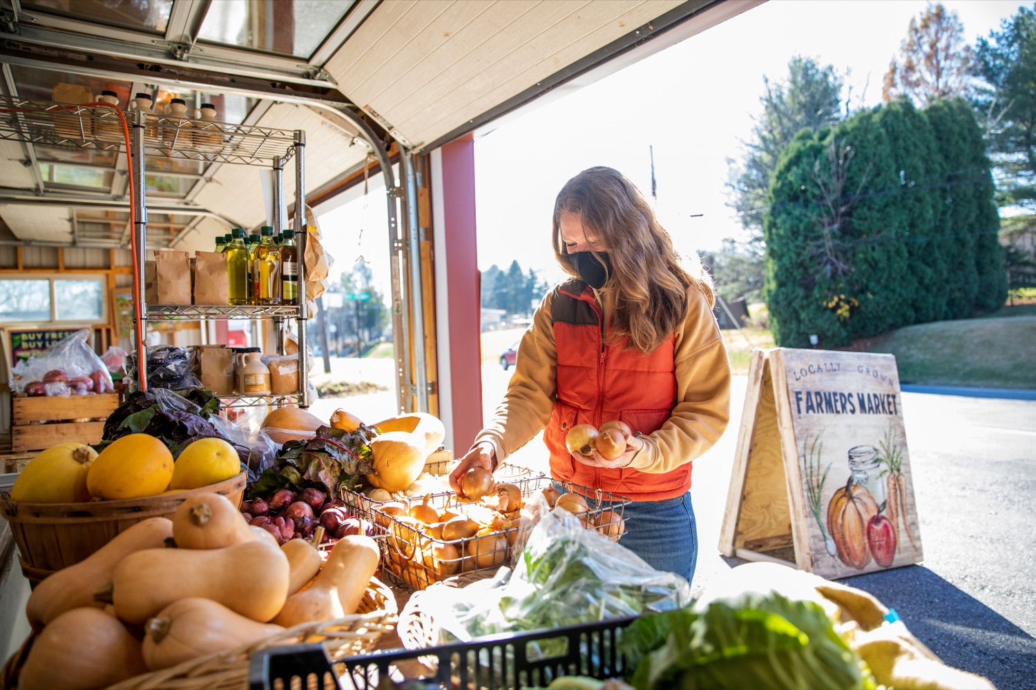"""<a href=""""https://filesource.wostreaming.net/commonwealthofpa/photo/18325_AGRIC_Farm_Show_NK_012.jpg"""" target=""""_blank"""">⇣Download Photo<br></a>Allison Czapp, 40, director of Buy Fresh Buy Local Greater Lehigh Valley, shops for produce inside the Crooked Row Farm farm stand in Orefield on Friday, November 20, 2020."""