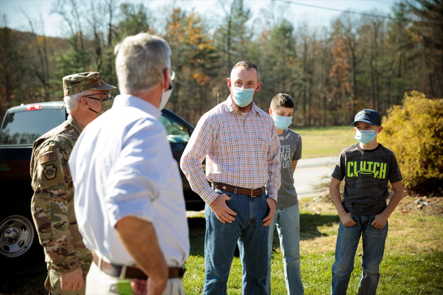"""<a href=""""https://filesource.wostreaming.net/commonwealthofpa/photo/18388_AGRIC_Veteran_Farmers_NK_003.jpg"""" target=""""_blank"""">⇣Download Photo<br></a>U.S. Marine Corps Veteran Daniel Hubbard, center, stands with his children, Lane, 12, center right, and Joshua, 10, right, as they talk with Anthony J. Carrelli, Pennsylvanias adjutant general and head of the Department of Military and Veterans Affairs, center left, and Agriculture Secretary Russell Redding on Hubbard's Family Ranch in Adams County on Friday, November 6, 2020. Hubbard's Family Ranch received grants in September through the states $10 million Fresh Food Financing Initiative COVID-19 Relief Fund to expand access to fresh food in low-income communities during the pandemic."""