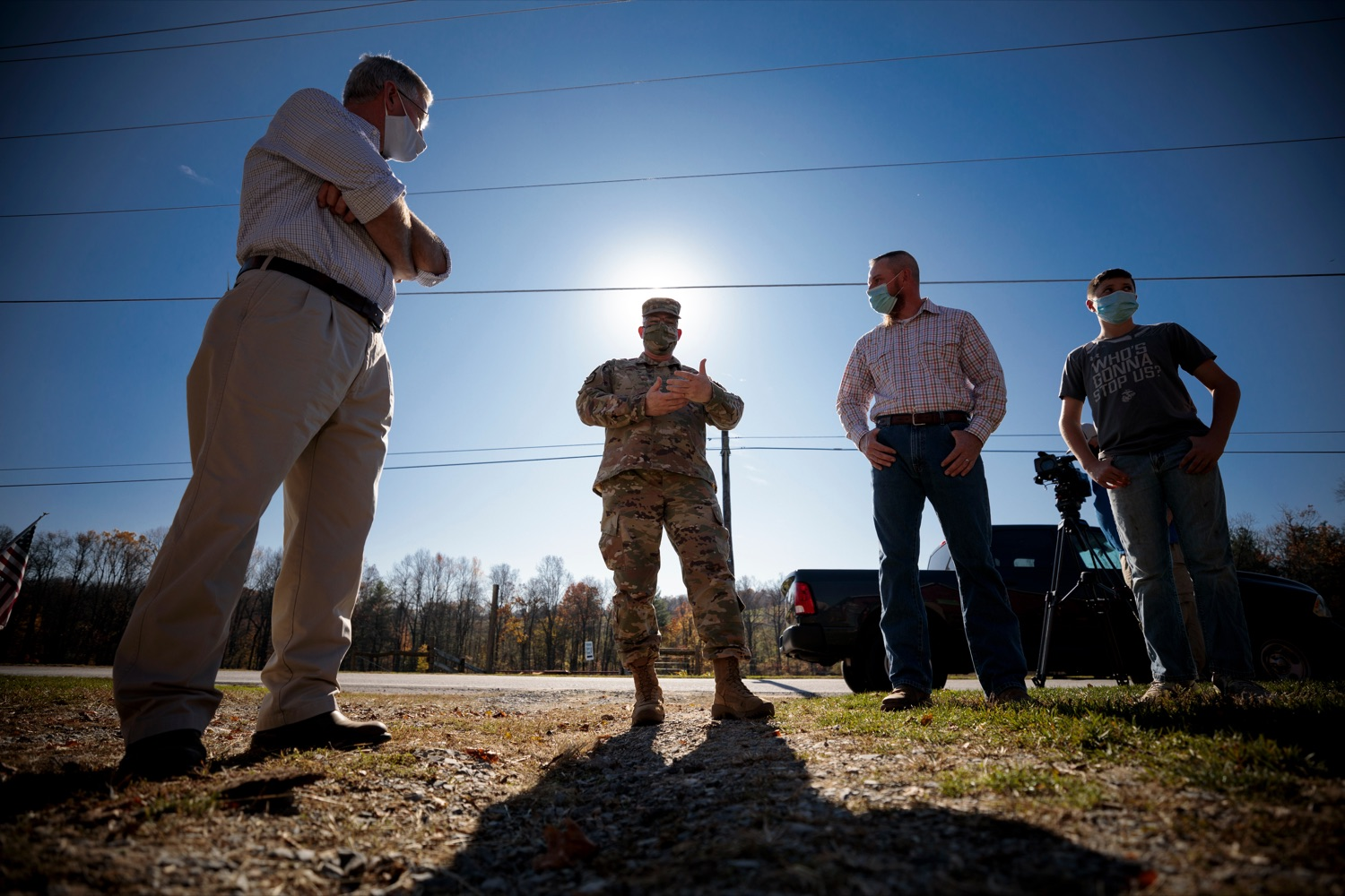 """<a href=""""https://filesource.wostreaming.net/commonwealthofpa/photo/18388_AGRIC_Veteran_Farmers_NK_005.jpg"""" target=""""_blank"""">⇣Download Photo<br></a>U.S. Marine Corps Veteran Daniel Hubbard, center right, stands with his son Lane, 12, right, as they talk with Anthony J. Carrelli, Pennsylvanias adjutant general and head of the Department of Military and Veterans Affairs, center left, and Agriculture Secretary Russell Redding on Hubbard's Family Ranch in Adams County on Friday, November 6, 2020. Hubbard's Family Ranch received grants in September through the states $10 million Fresh Food Financing Initiative COVID-19 Relief Fund to expand access to fresh food in low-income communities during the pandemic."""