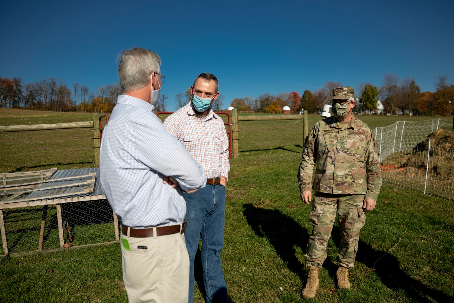 """<a href=""""https://filesource.wostreaming.net/commonwealthofpa/photo/18388_AGRIC_Veteran_Farmers_NK_013.jpg"""" target=""""_blank"""">⇣Download Photo<br></a>U.S. Marine Corps Veteran Daniel Hubbard, center, talks with Anthony J. Carrelli, Pennsylvanias adjutant general and head of the Department of Military and Veterans Affairs, right, and Agriculture Secretary Russell Redding on Hubbard's Family Ranch in Adams County on Friday, November 6, 2020. Hubbard's Family Ranch received grants in September through the states $10 million Fresh Food Financing Initiative COVID-19 Relief Fund to expand access to fresh food in low-income communities during the pandemic."""