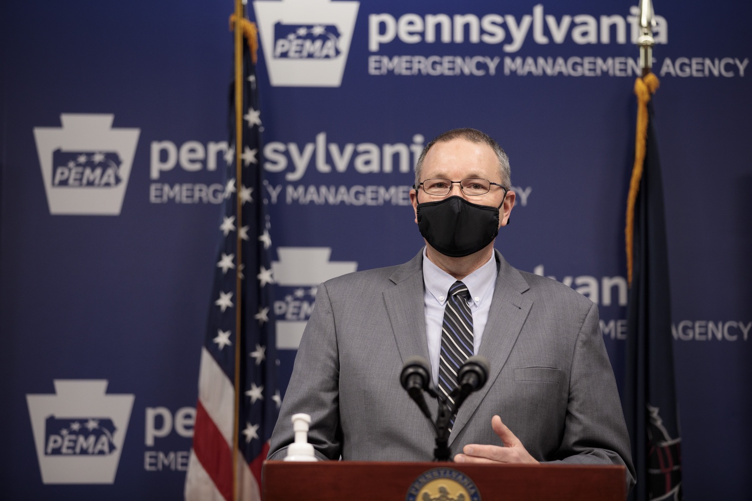 """<a href=""""https://filesource.wostreaming.net/commonwealthofpa/photo/18472_gov_vaccine_dz_15.jpg"""" target=""""_blank"""">⇣Download Photo<br></a>PEMA Director Randy Padfield speaks at the press conference.  The commonwealths COVID-19 vaccination distribution plan was designed to be fluid and flexible to meet guidance and recommendations from the federal government. Today, Governor Tom Wolf and Secretary of Health Dr. Rachel Levine announced the fourth version of the plan, detailing the updates and how the state is working to ensure safe, swift implementation. Harrisburg, PA  January 8, 2021"""