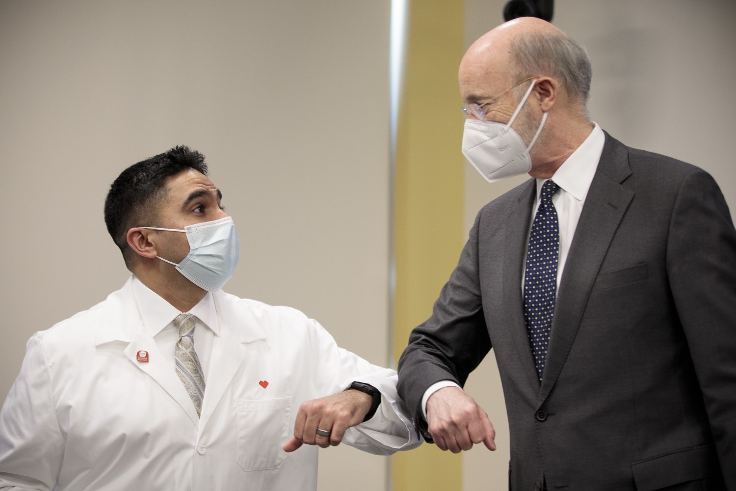 """<a href=""""https://filesource.wostreaming.net/commonwealthofpa/photo/18548_gov_vaccine_dz_10.jpg"""" target=""""_blank"""">⇣Download Photo<br></a>Pennsylvania Governor Tom Wolf greeting CVS Health District Leader Andreas Chandra.  Governor Tom Wolf today marked a milestone in the implementation of the states COVID-19 vaccination plan with the announcement that more than 600 skilled nursing facilities have received first and second doses of the vaccine, and in total more than 315,000 doses of vaccine administered among all long-term care facilities being vaccinated by CVS and Walgreens.  Harrisburg, PA - February 23, 2021"""
