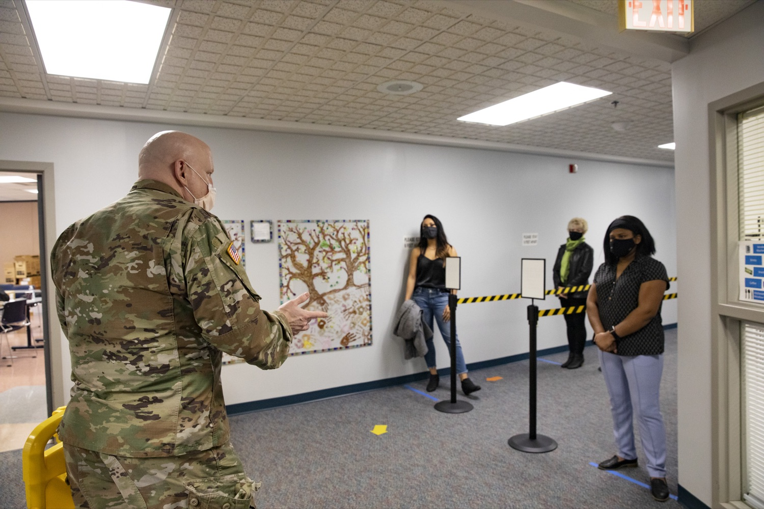 """<a href=""""https://filesource.wostreaming.net/commonwealthofpa/photo/18591_gov_vaccineIU_cz_03.jpg"""" target=""""_blank"""">⇣Download Photo<br></a>Members of the Pennsylvania National Guard vaccinate educators at the Capital Area Intermediate Unit in Summerdale, PA on March 11, 2021."""