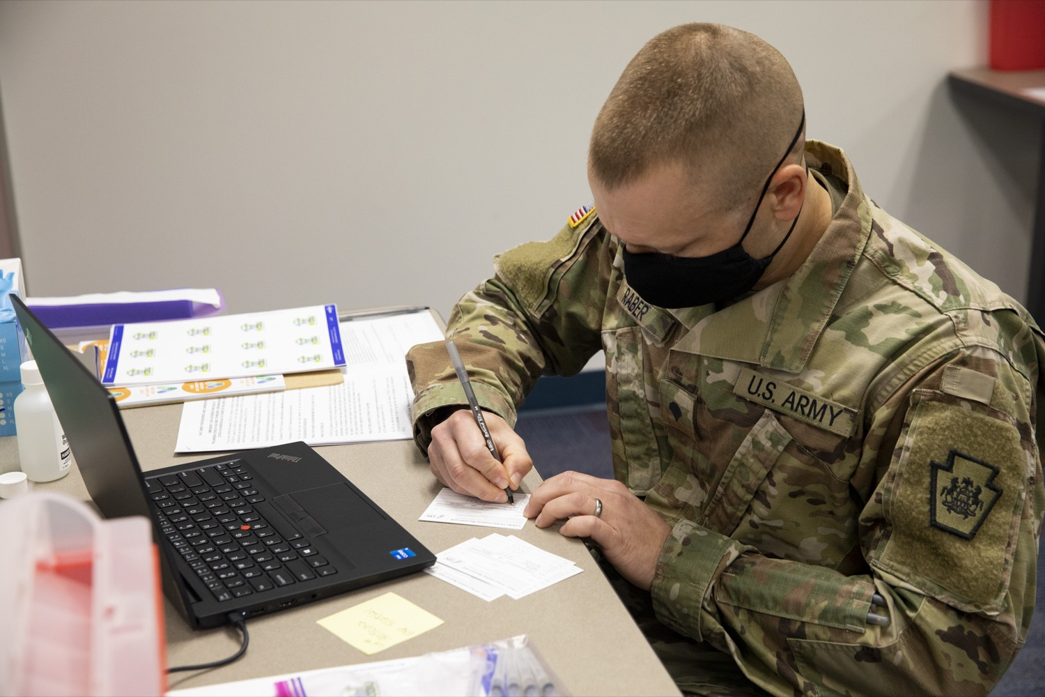 """<a href=""""https://filesource.wostreaming.net/commonwealthofpa/photo/18591_gov_vaccineIU_cz_04.jpg"""" target=""""_blank"""">⇣Download Photo<br></a>Members of the Pennsylvania National Guard vaccinate educators at the Capital Area Intermediate Unit in Summerdale, PA on March 11, 2021."""