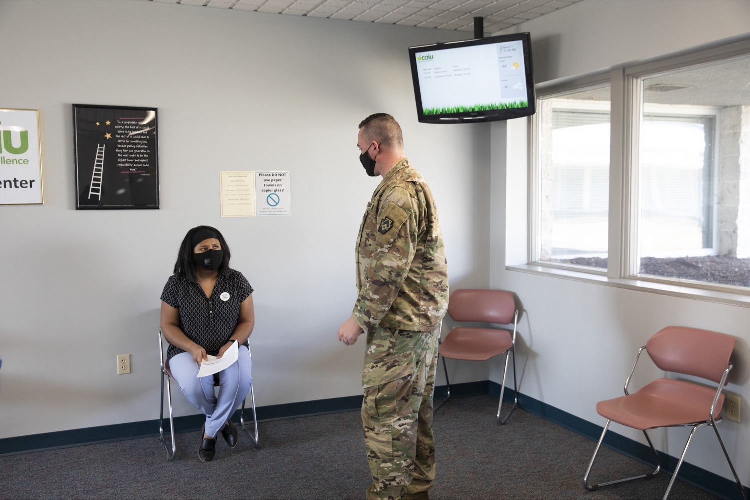 """<a href=""""https://filesource.wostreaming.net/commonwealthofpa/photo/18591_gov_vaccineIU_cz_06.jpg"""" target=""""_blank"""">⇣Download Photo<br></a>Members of the Pennsylvania National Guard vaccinate educators at the Capital Area Intermediate Unit in Summerdale, PA on March 11, 2021."""