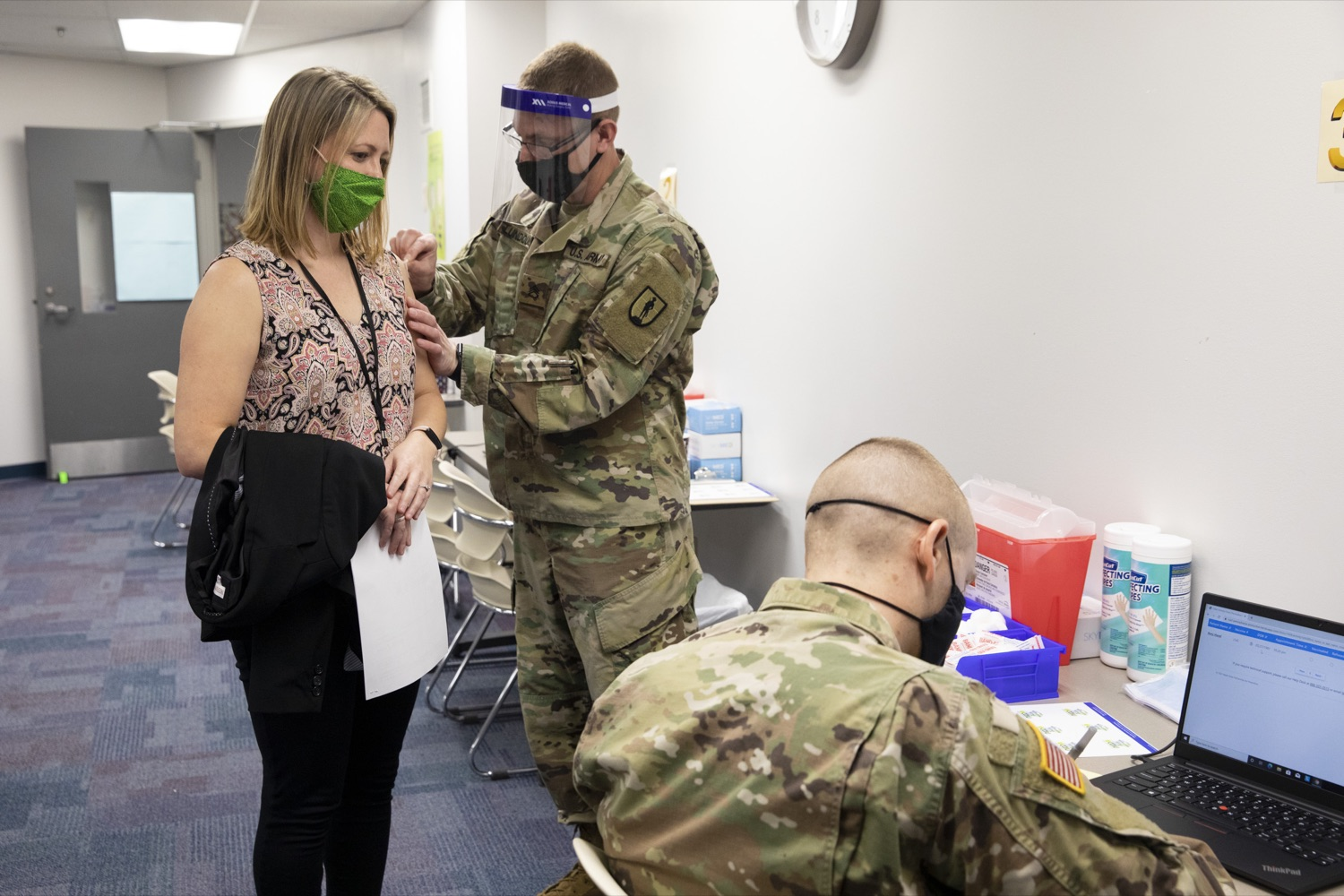 """<a href=""""https://filesource.wostreaming.net/commonwealthofpa/photo/18591_gov_vaccineIU_cz_08.jpg"""" target=""""_blank"""">⇣Download Photo<br></a>Members of the Pennsylvania National Guard vaccinate educators at the Capital Area Intermediate Unit in Summerdale, PA on March 11, 2021."""